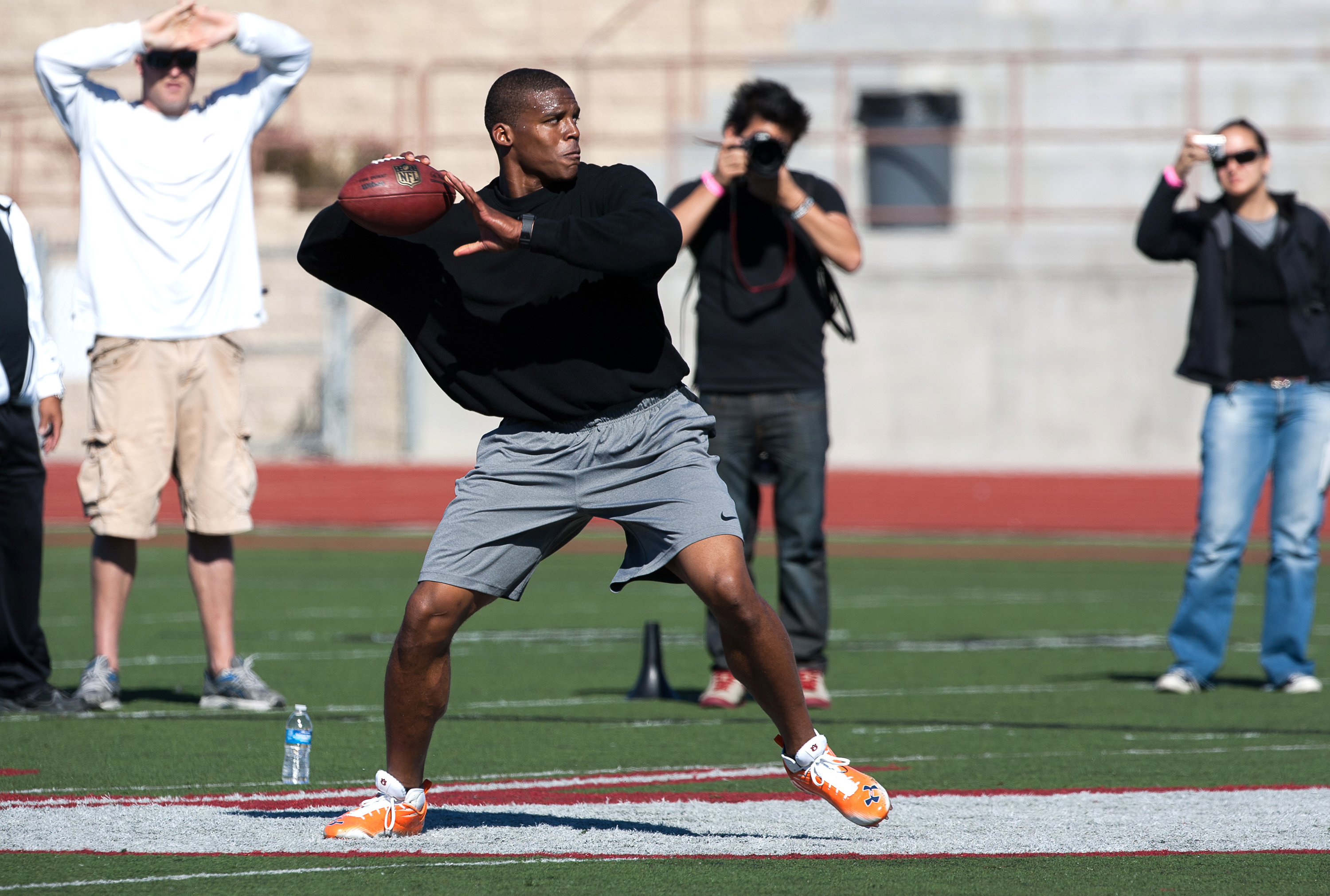 SAN DIEGO, CA - FEBRUARY 10: 2010 Heisman Trophy winning quarterback Cam Newton of Auburn throws the ball during his workout routine for the media at Cathedral High School's sports stadium on February 10, 2011 in San Diego, California. (Photo by Kent Horn