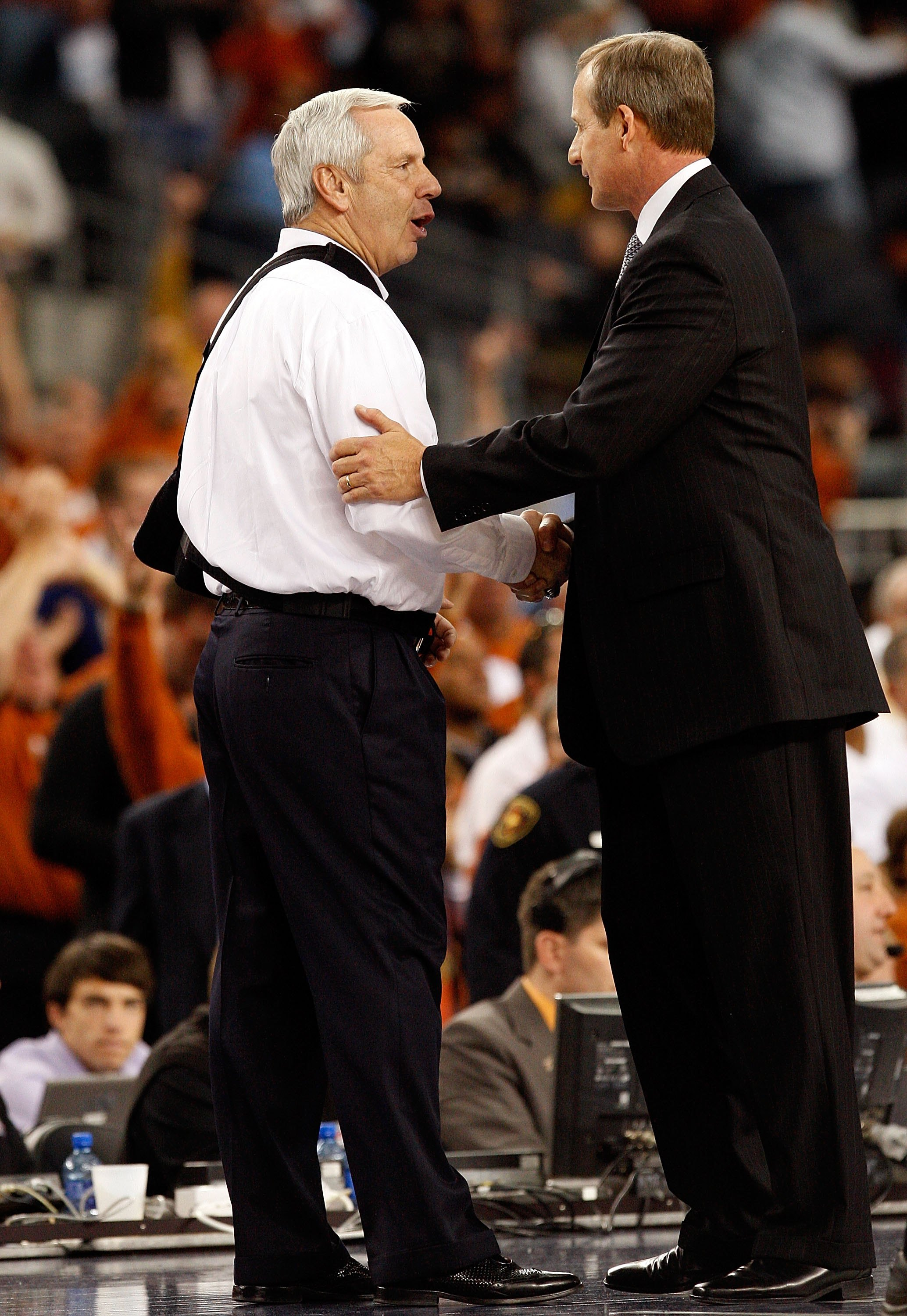 ARLINGTON, TX - DECEMBER 19:  Head coach Roy Williams of the North Carolina Tar Heels greets Rick Barnes of the Texas Longhorns at Cowboys Stadium on December 19, 2009 in Arlington, Texas.  (Photo by Ronald Martinez/Getty Images)