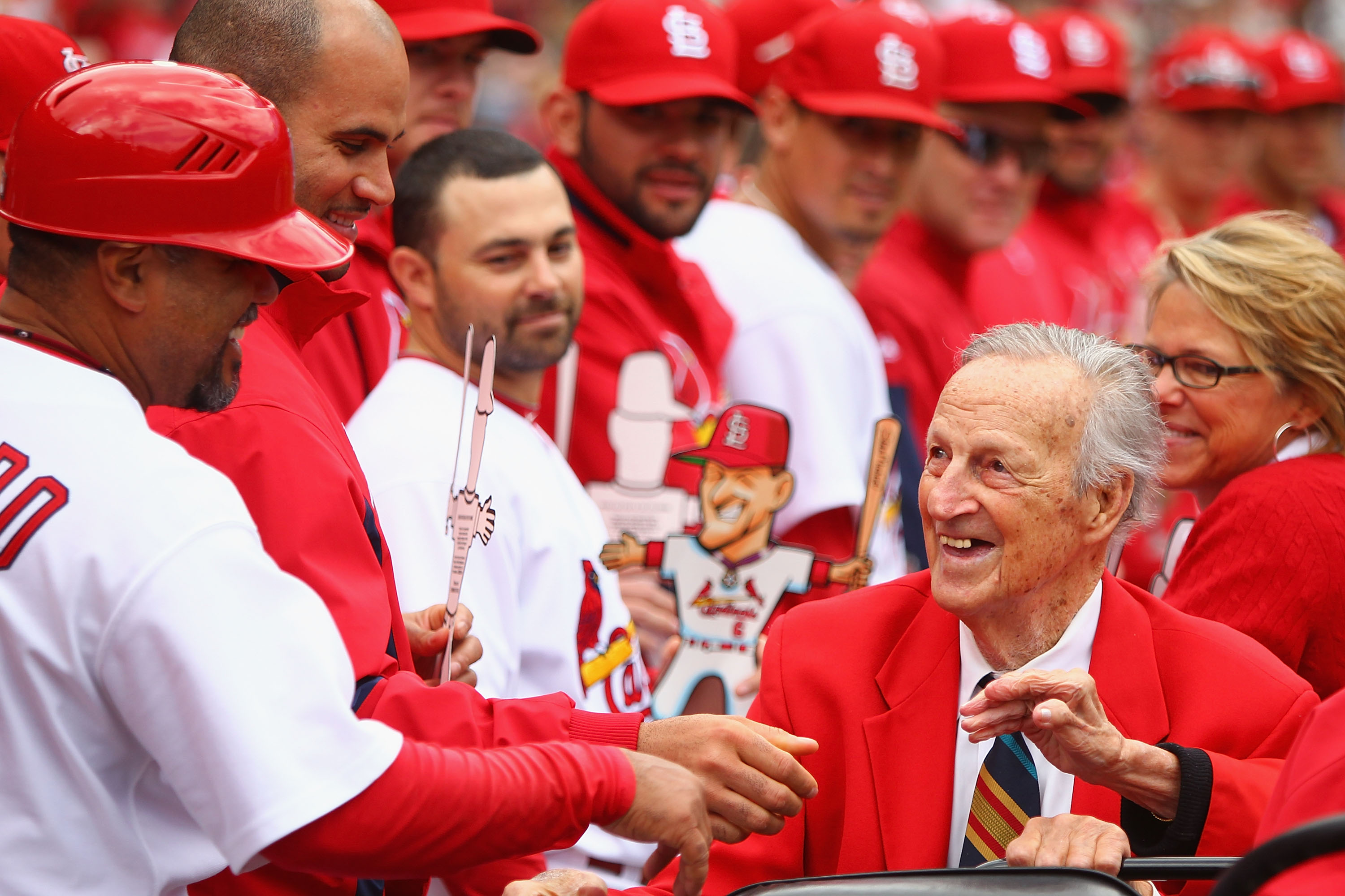 ST. LOUIS - OCTOBER 2: Former St. Louis Cardinals player Stan Musial greets members of the St. Louis Cardinals in between innings against the Colorado Rockies at Busch Stadium on October 2, 2010 in St. Louis, Missouri.  The Cardinals beat the Rockies 1-0