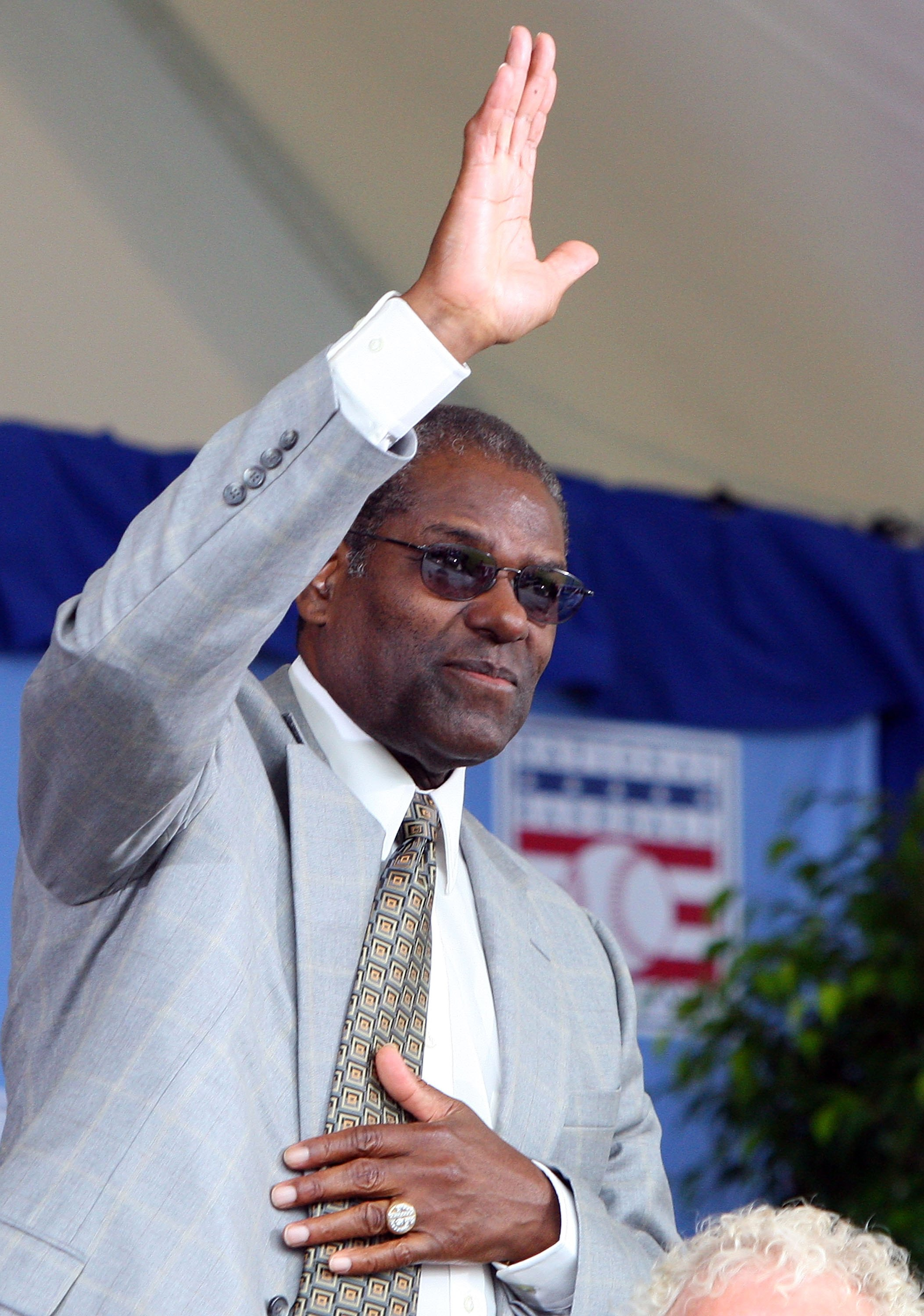 COOPERSTOWN, NY - JULY 26:  Hall of Famer Bob Gibson waves to the crowd as he is introduced at Clark Sports Center during the 2009  Baseball Hall of Fame induction ceremony on July 26, 2009 in Cooperstown, New York.  (Photo by Jim McIsaac/Getty Images)