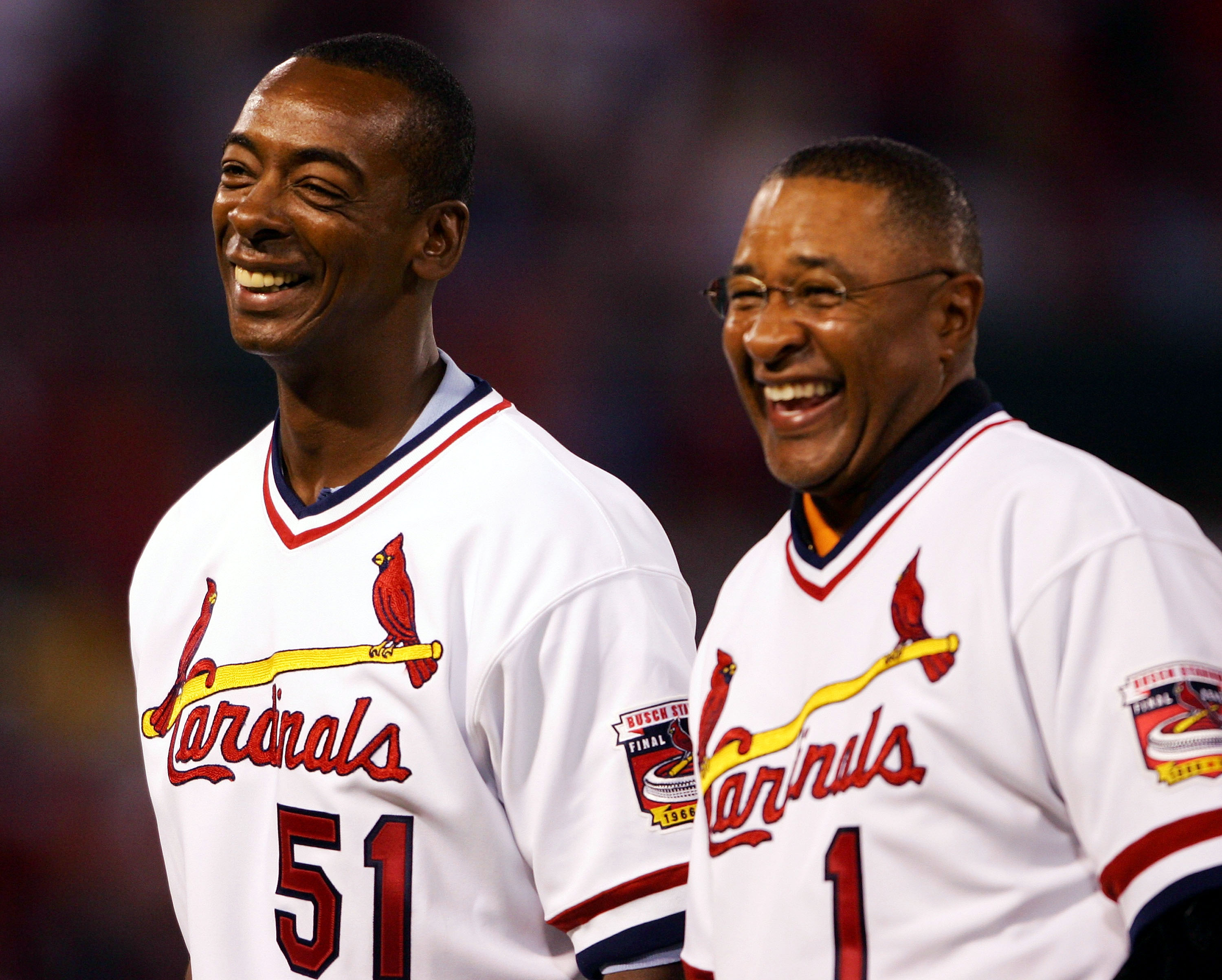 ST. LOUIS - SEPTEMBER 30:  Ozzie Smith #1 and Willie McGee #51 of the 1985 St. Louis Cardinals team stand on the field before the game on September 30, 2005 at Busch Stadium in St. Louis, Missouri.  (Photo by Elsa/Getty Images).