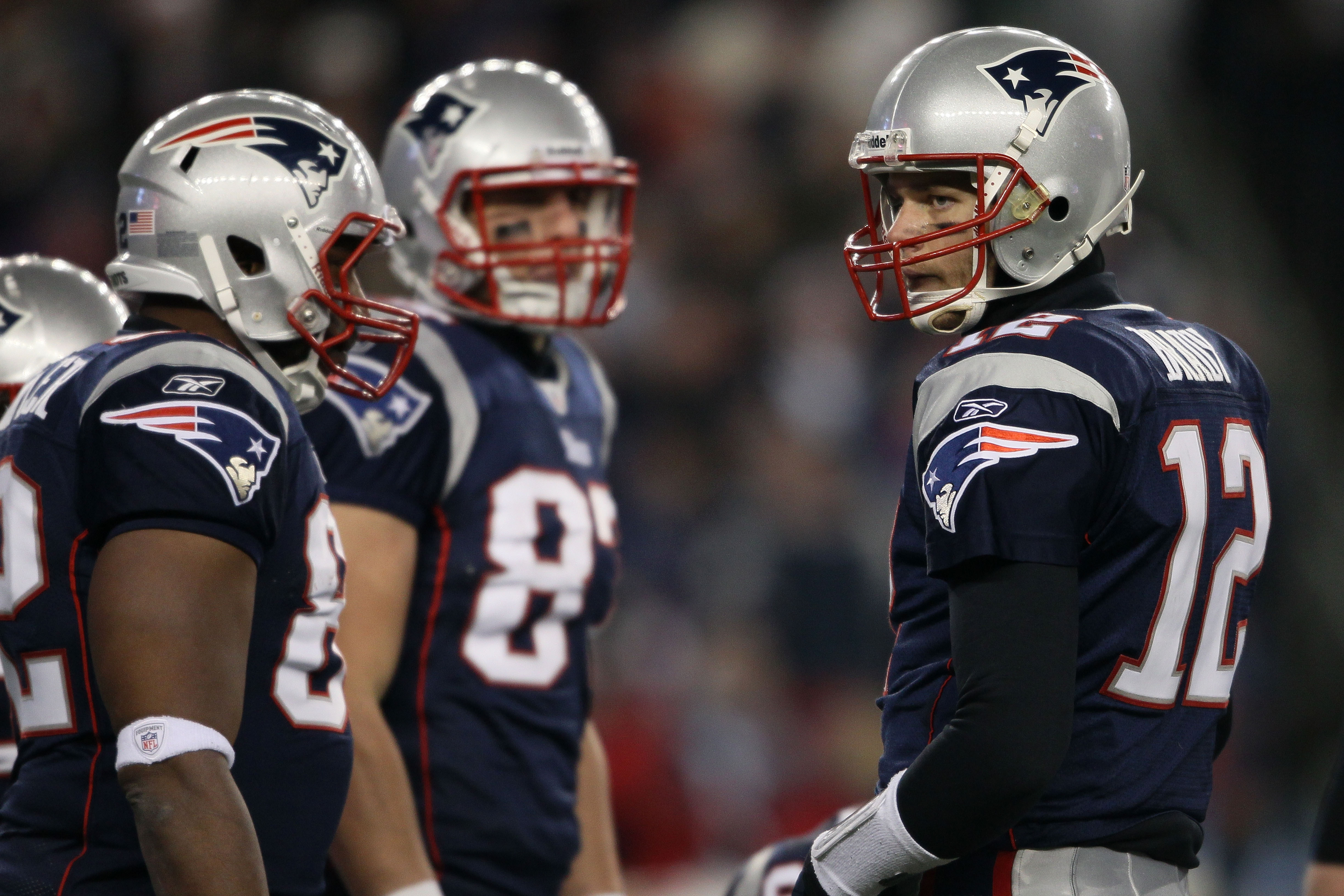 FOXBORO, MA - JANUARY 16:  Quarterback Tom Brady #12 of the New England Patriots stands on the field during their 2011 AFC divisional playoff game against the New York Jets at Gillette Stadium on January 16, 2011 in Foxboro, Massachusetts.  (Photo by Elsa