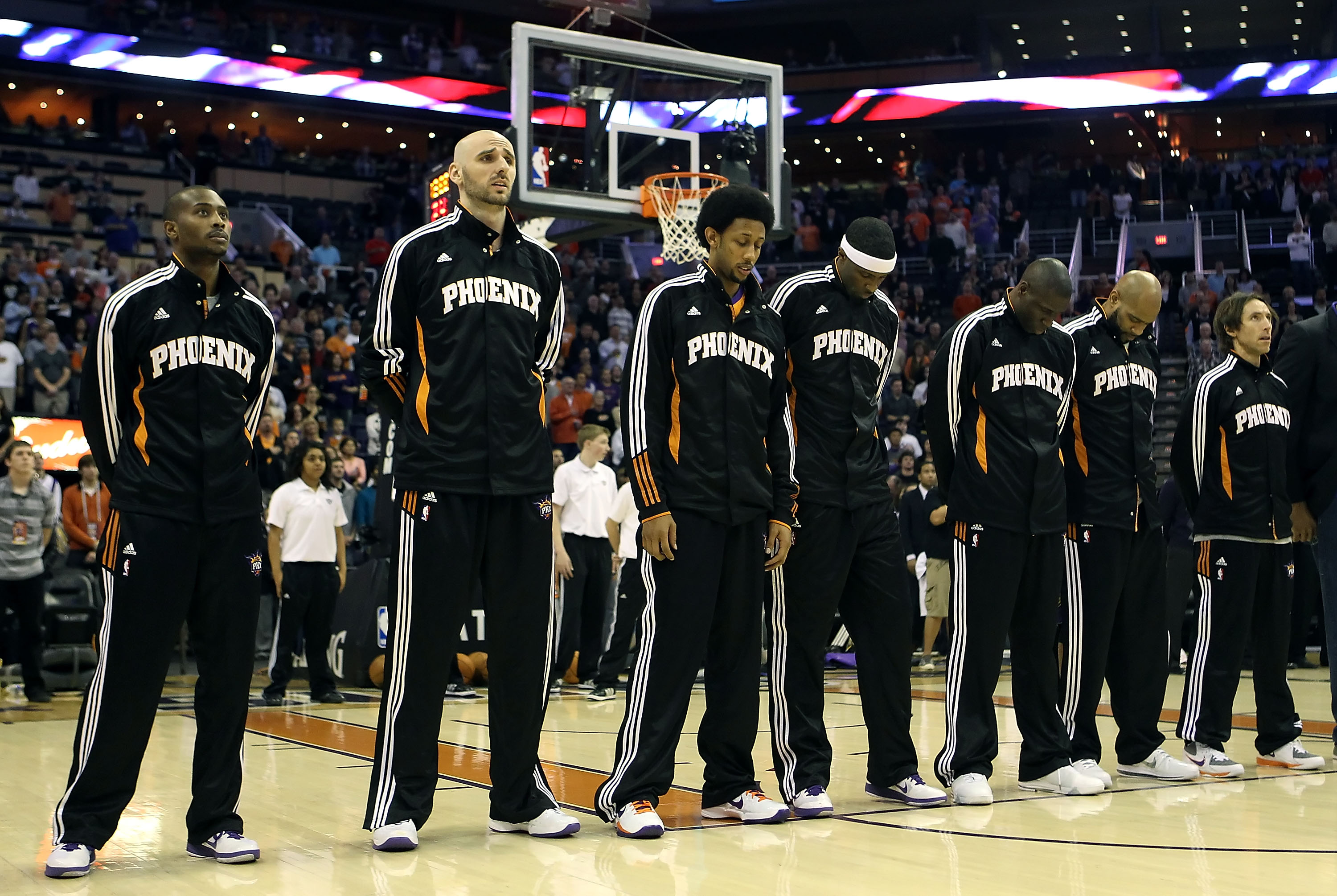 PHOENIX, AZ - JANUARY 14:  The Phoenix Suns stand attended for the National Anthem before the NBA game against the Portland Trail Blazers at US Airways Center on January 14, 2011 in Phoenix, Arizona. The Suns defeated the Trail Blazers 115-111. NOTE TO US