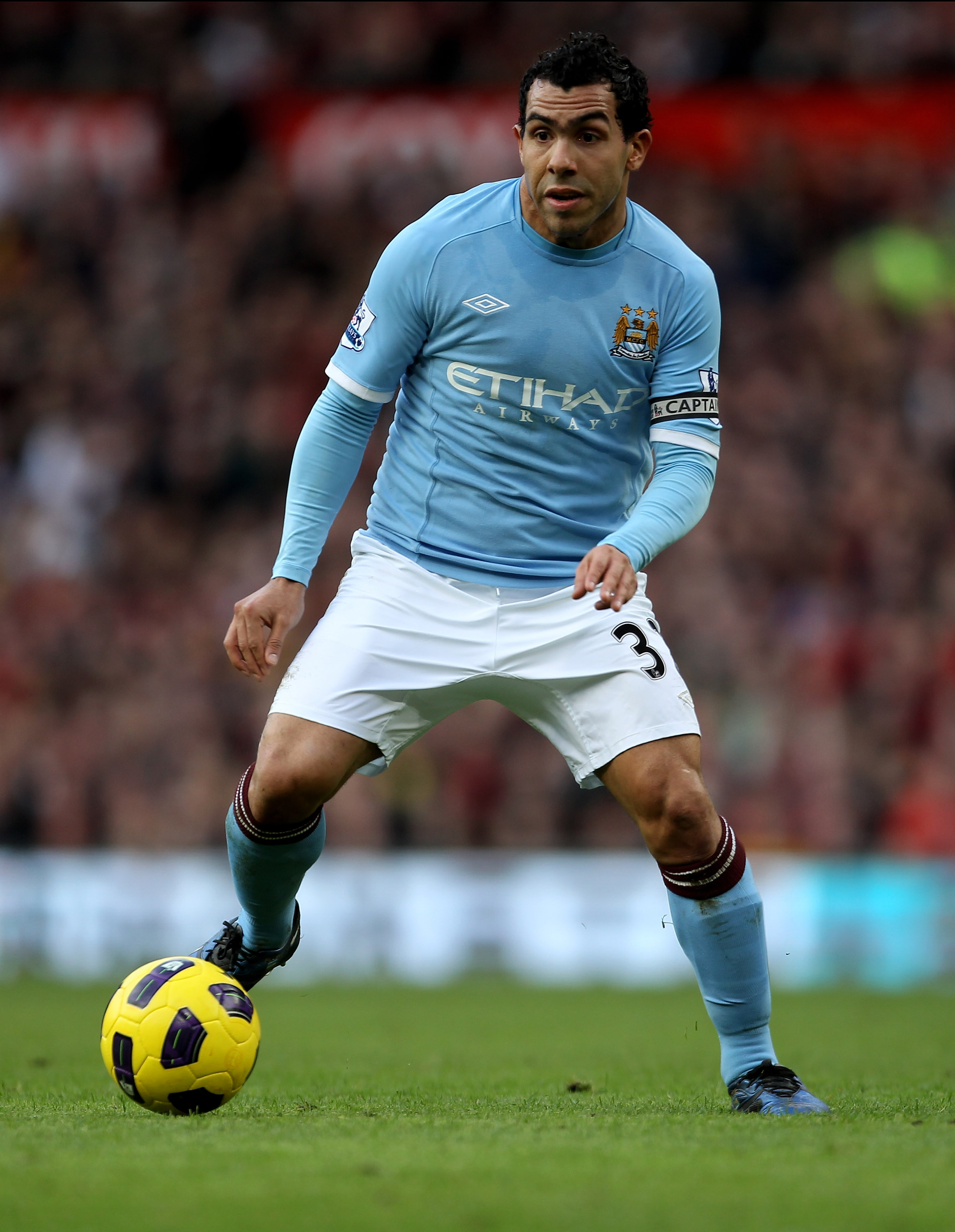 MANCHESTER, ENGLAND - FEBRUARY 12:  Carlos Tevez of Manchester City in action during the Barclays Premier League match between Manchester United and Manchester City at Old Trafford on February 12, 2011 in Manchester, England.  (Photo by Alex Livesey/Getty