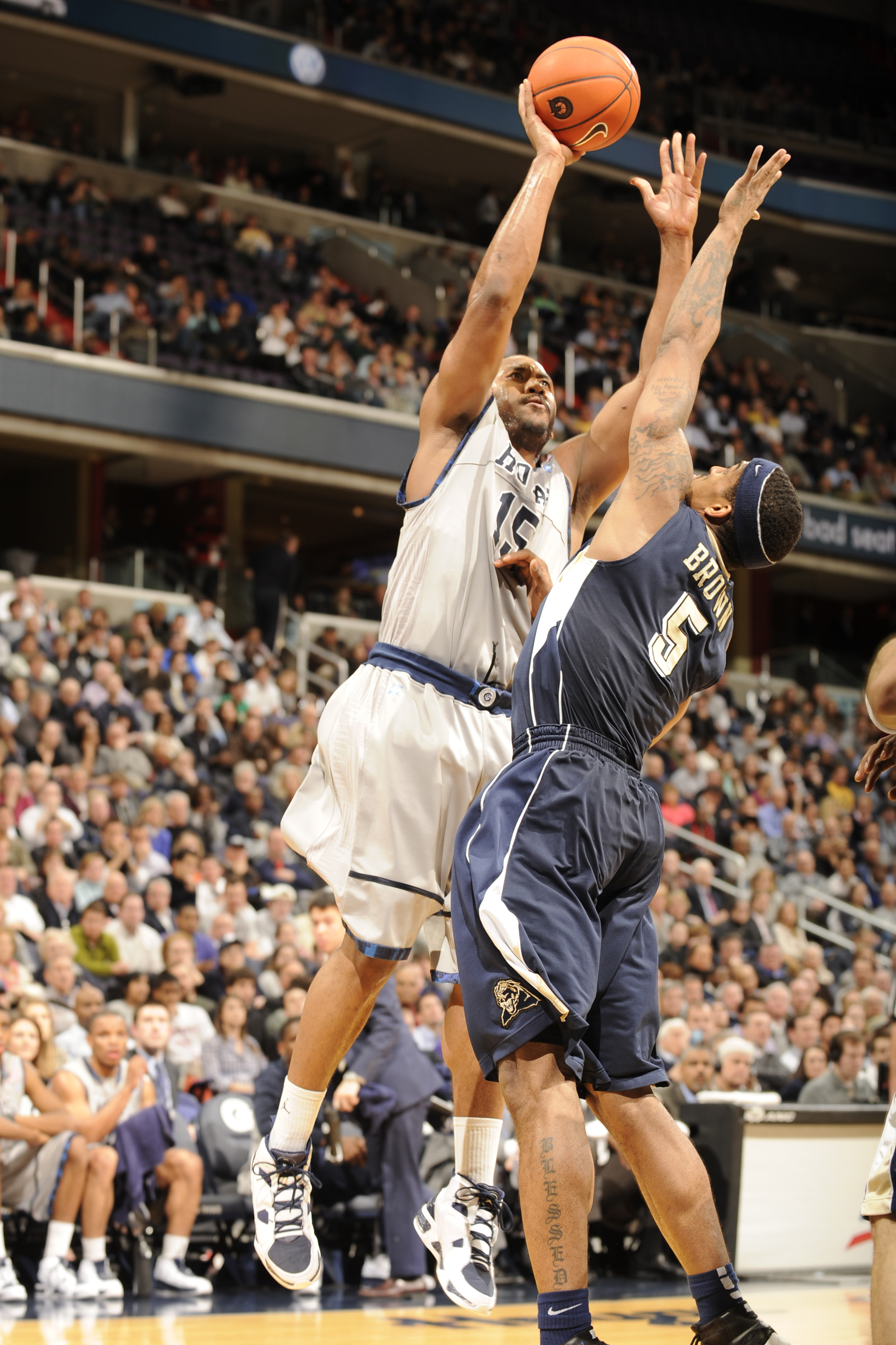 WASHINGTON, DC- JANUARY 12:  Austin Freeman #15 of the Georgetown Hoyas drives to the basket during a college basketball game against  Gilbert Brown #5 ofthe Pittsburgh Panthers on January 12, 2011 at the Verizon Center in Washington, DC.   The Panthers w