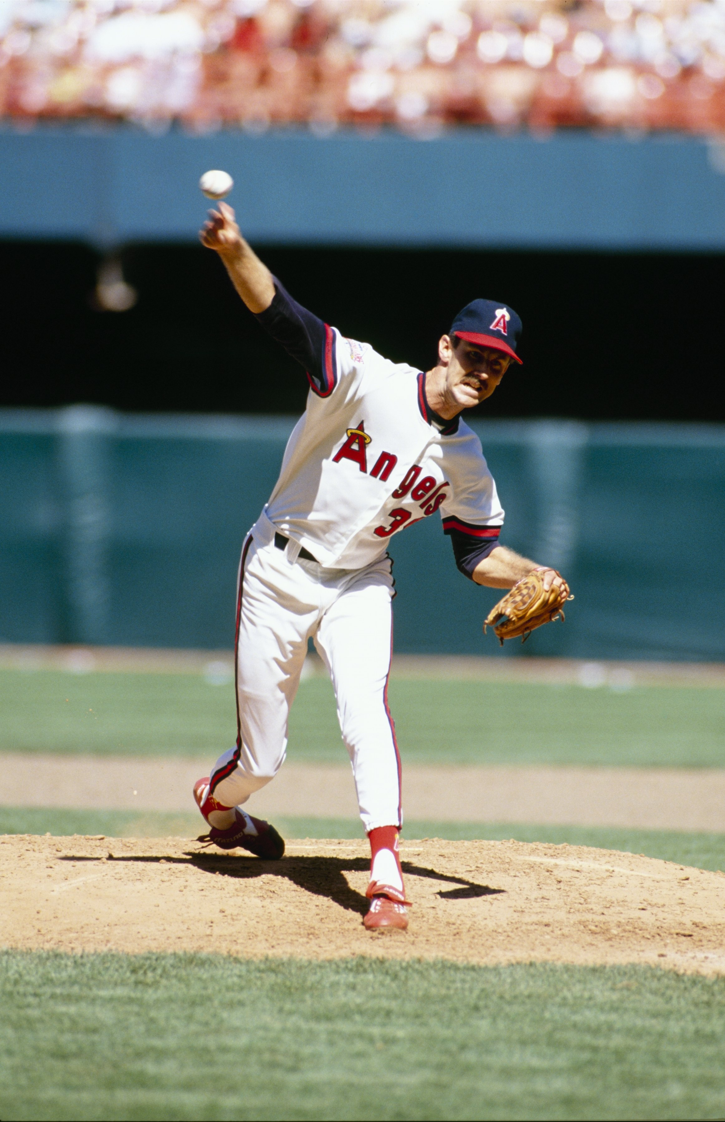 ANAHEIM, CA - 1989:  Mike Witt of the California Angels pitches during a game in the 1989 season at Anaheim Stadium in Anaheim, California. (Photo by Tim DeFrisco/Getty Images)