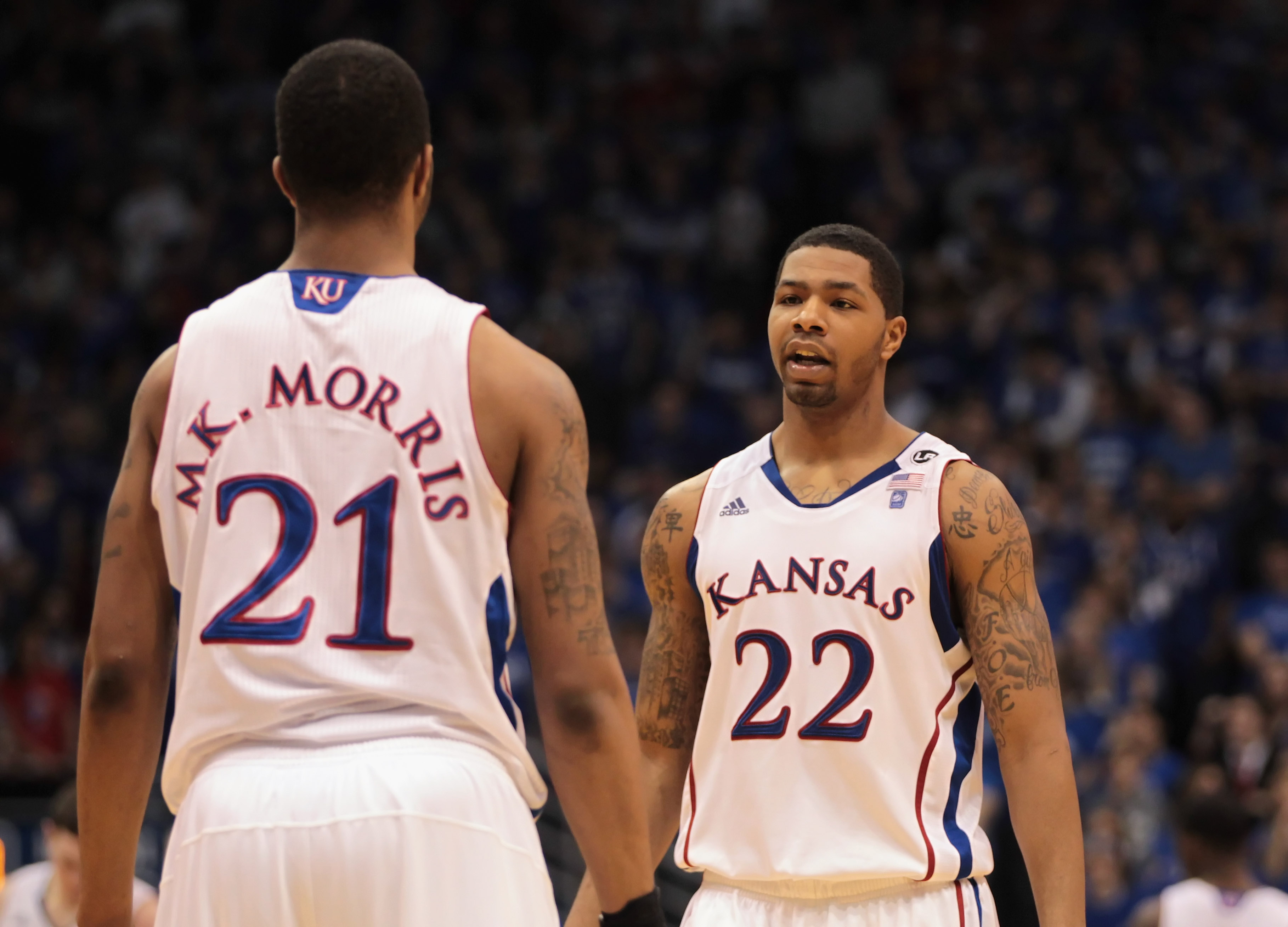 LAWRENCE, KS - FEBRUARY 12:  Marcus Morris #22 of the Kansas Jayhawks talks with his brother Markieff Morris #21 during the game against the Iowa State Cyclones on February 12, 2011 at Allen Fieldhouse in Lawrence, Kansas.  (Photo by Jamie Squire/Getty Im