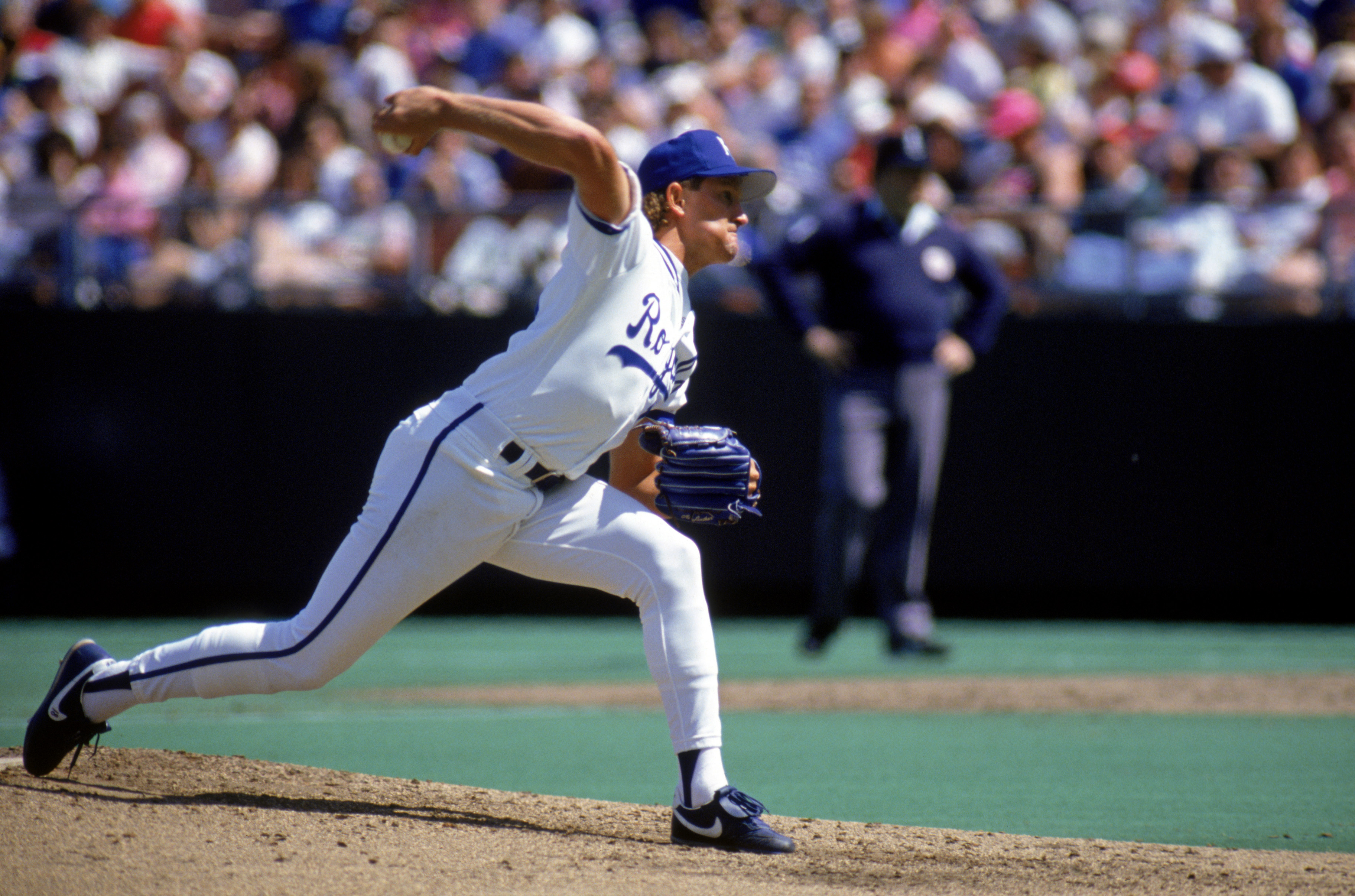 KANSAS CITY, MO - 1990:  Bret Saberhagen #31 of the Kansas City Royals winds up for a pitch during a game in 1990 at Royals Stadium in Kansas City, Missouri.  (Photo by Jonathan Daniel/Getty Images)