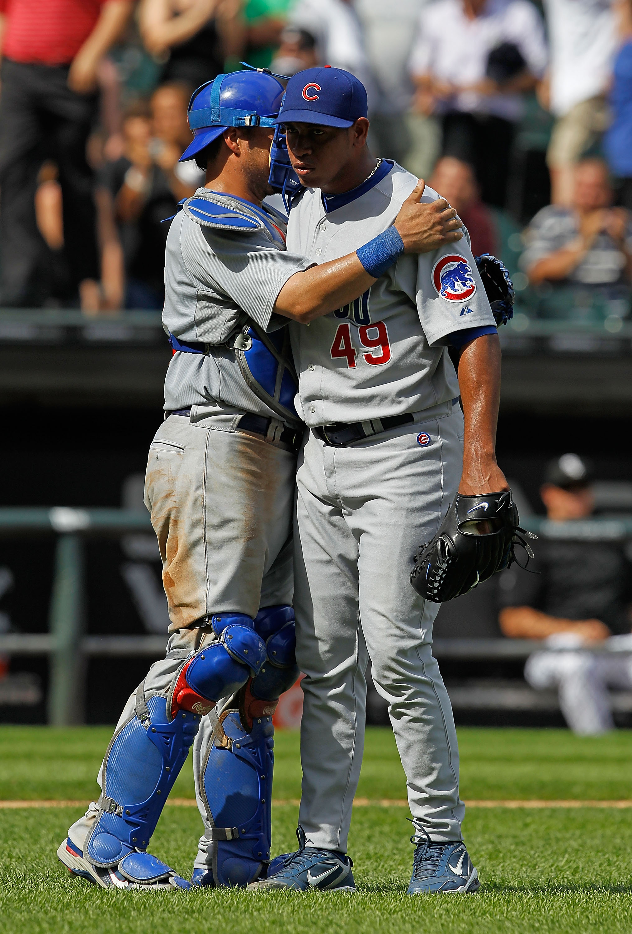 CHICAGO - JUNE 27: Geovany Soto #18 of the Chicago Cubs hugs pitcher Carlos Marmol #49 after a close win against the Chicago White Sox at U.S. Cellular Field on June 27, 2010 in Chicago, Illinois. The Cubs defeated the White Sox 8-6. (Photo by Jonathan Da
