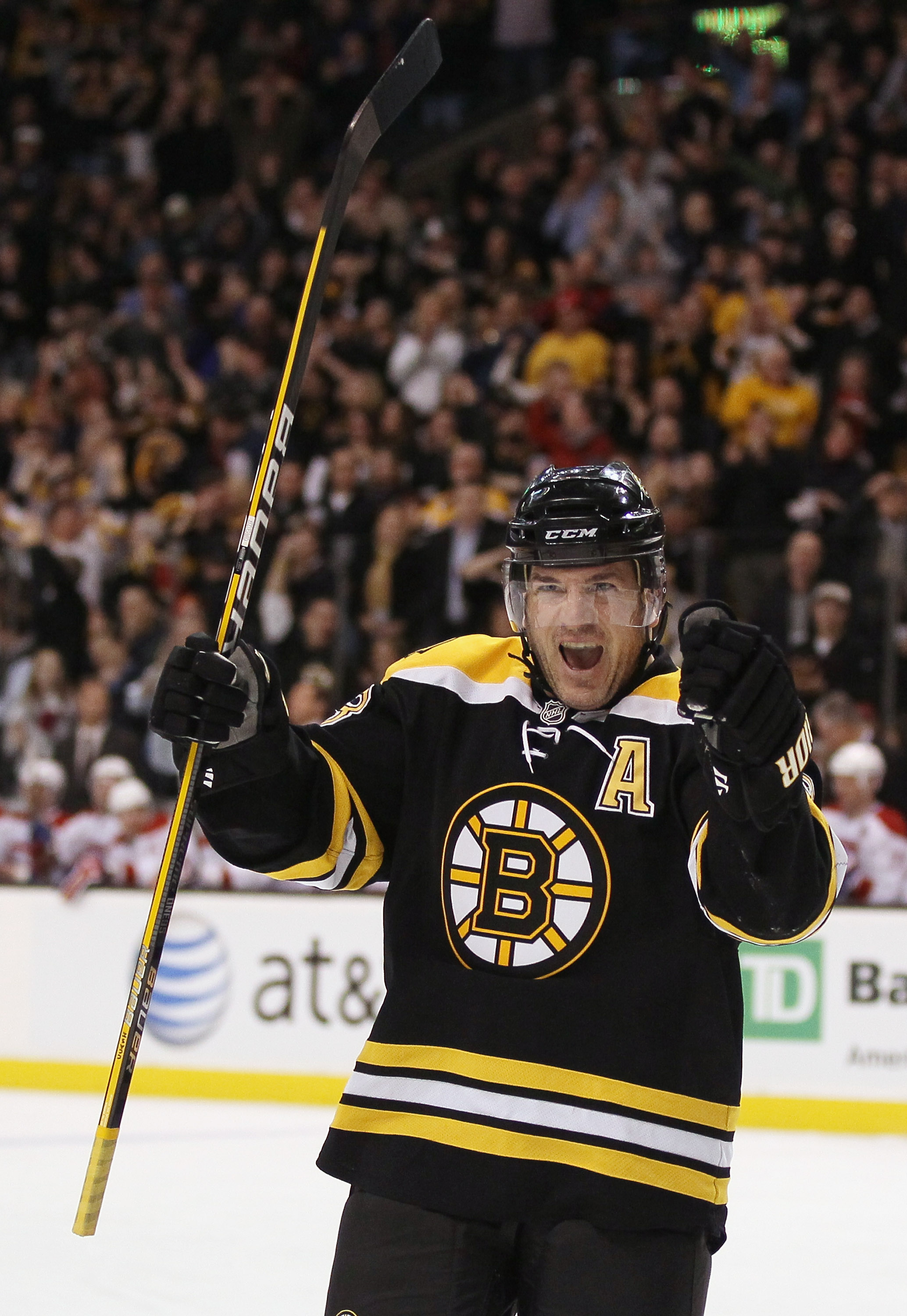 BOSTON, MA - FEBRUARY 09:  Mark Recchi #28 of the Boston Bruins celebrates teammate Brad Marchand's goal in the first period against the Montreal Canadiens on February 9, 2011 at the TD Garden in Boston, Massachusetts.  (Photo by Elsa/Getty Images)