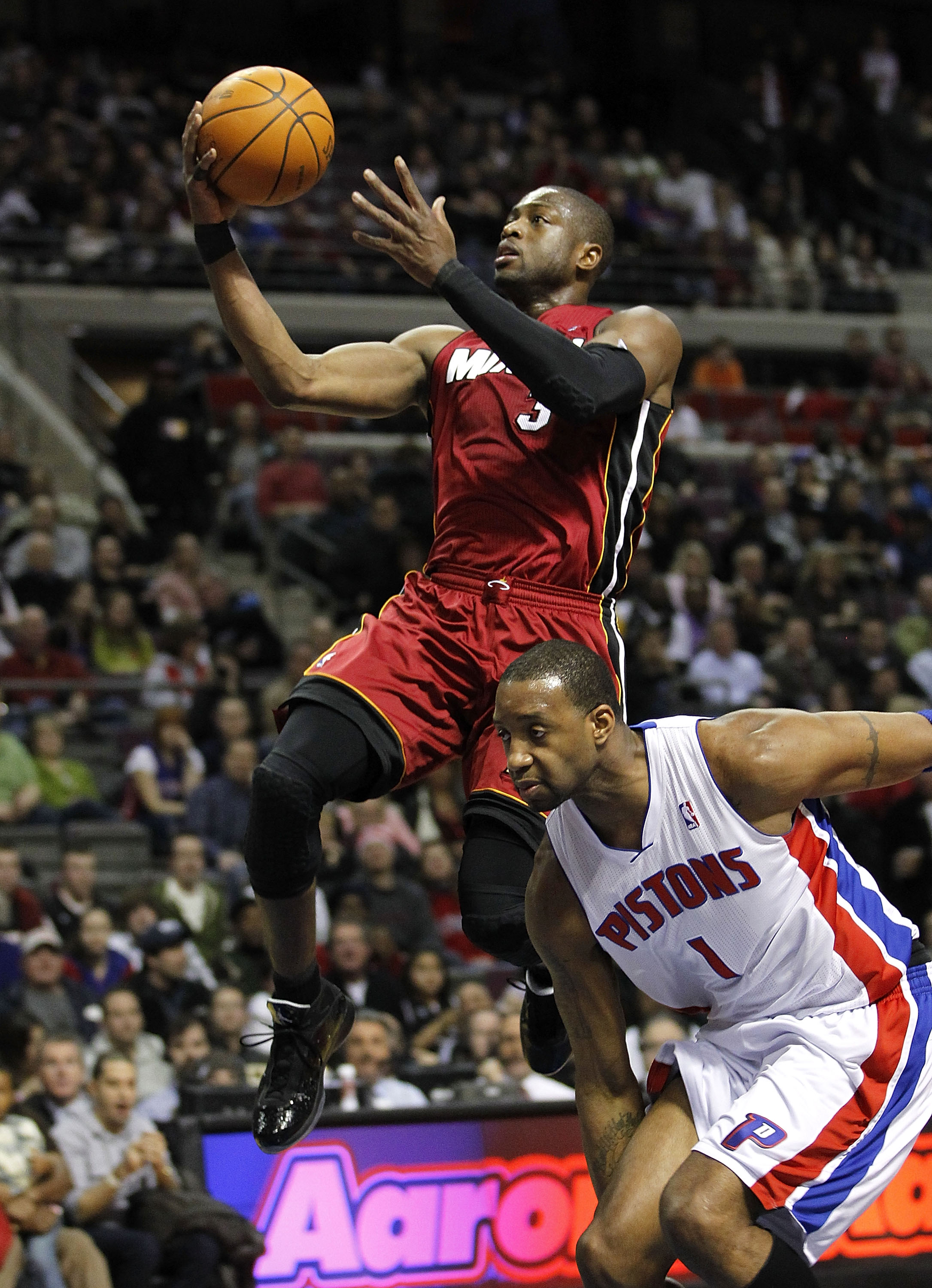 AUBURN HILLS, MI - FEBRUARY 11:  Dwyane Wade #3 of the Miami Heat gets to the basket in front of Tracy McGrady #1 of the Detroit Pistons at The Palace of Auburn Hills on February 11, 2011 in Auburn Hills, Michigan. NOTE TO USER: User expressly acknowledge