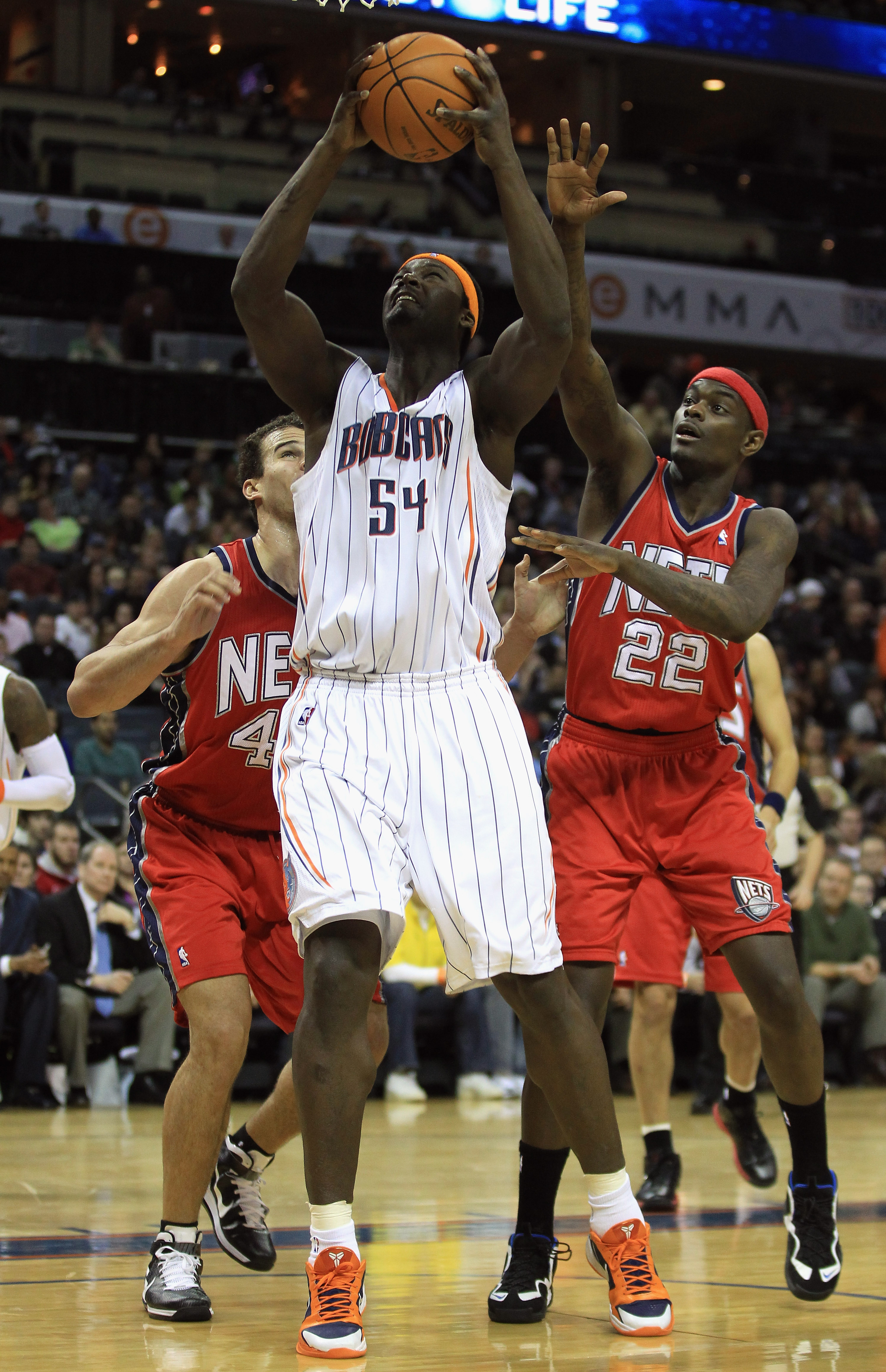 CHARLOTTE, NC - FEBRUARY 11:  Teammates Kris Humphries #43 and Anthony Morrow #22 of the New Jersey Nets try to stop Kwame Brown #54 of the Charlotte Bobcats during their game at Time Warner Cable Arena on February 11, 2011 in Charlotte, North Carolina. N