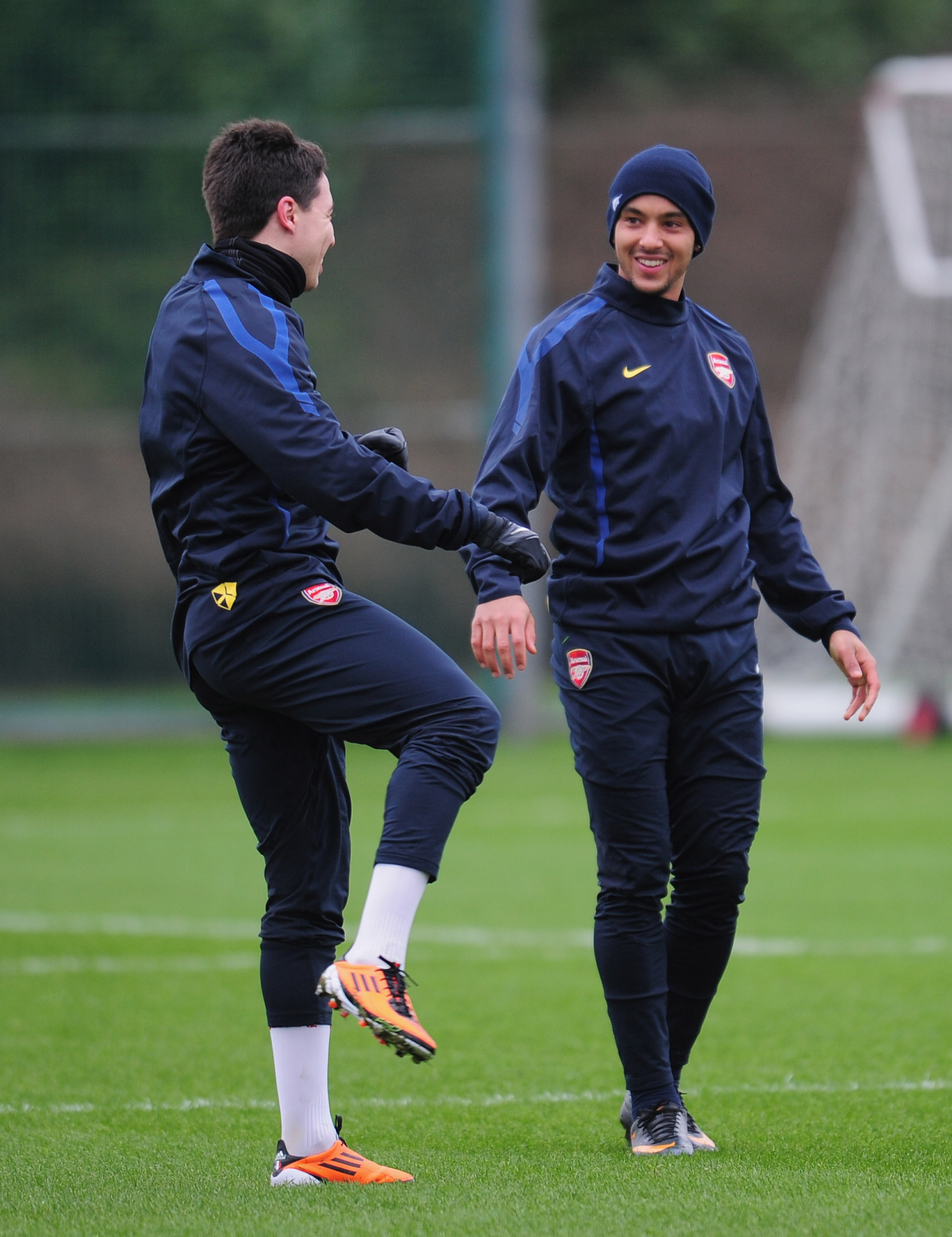 ST ALBANS, ENGLAND - FEBRUARY 15:  Theo Walcott and Samir Nasri of Arsenal warm-up during training at London Colney on February 15, 2011 in St Albans, England.  (Photo by Shaun Botterill/Getty Images)