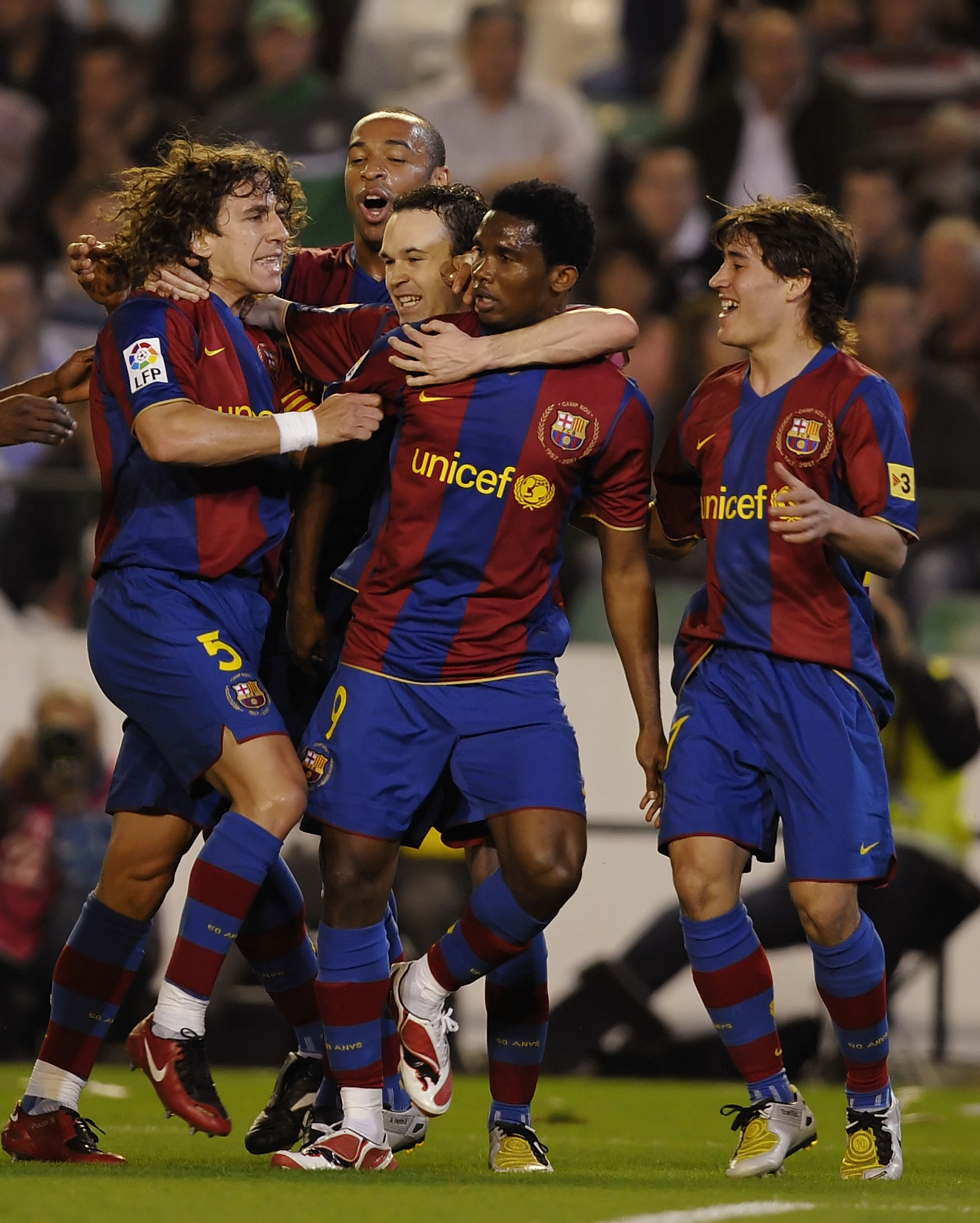 SEVILLE, SPAIN - MARCH 29: Samuel Eto'o (C) of Barcelona celebrates with Carles Puyol (L) and Andres Iniesta after he scored their second goal during the La Liga match between Real Betis and Barcelona at the Manuel Ruiz de Lopera stadium on March 29, 2008