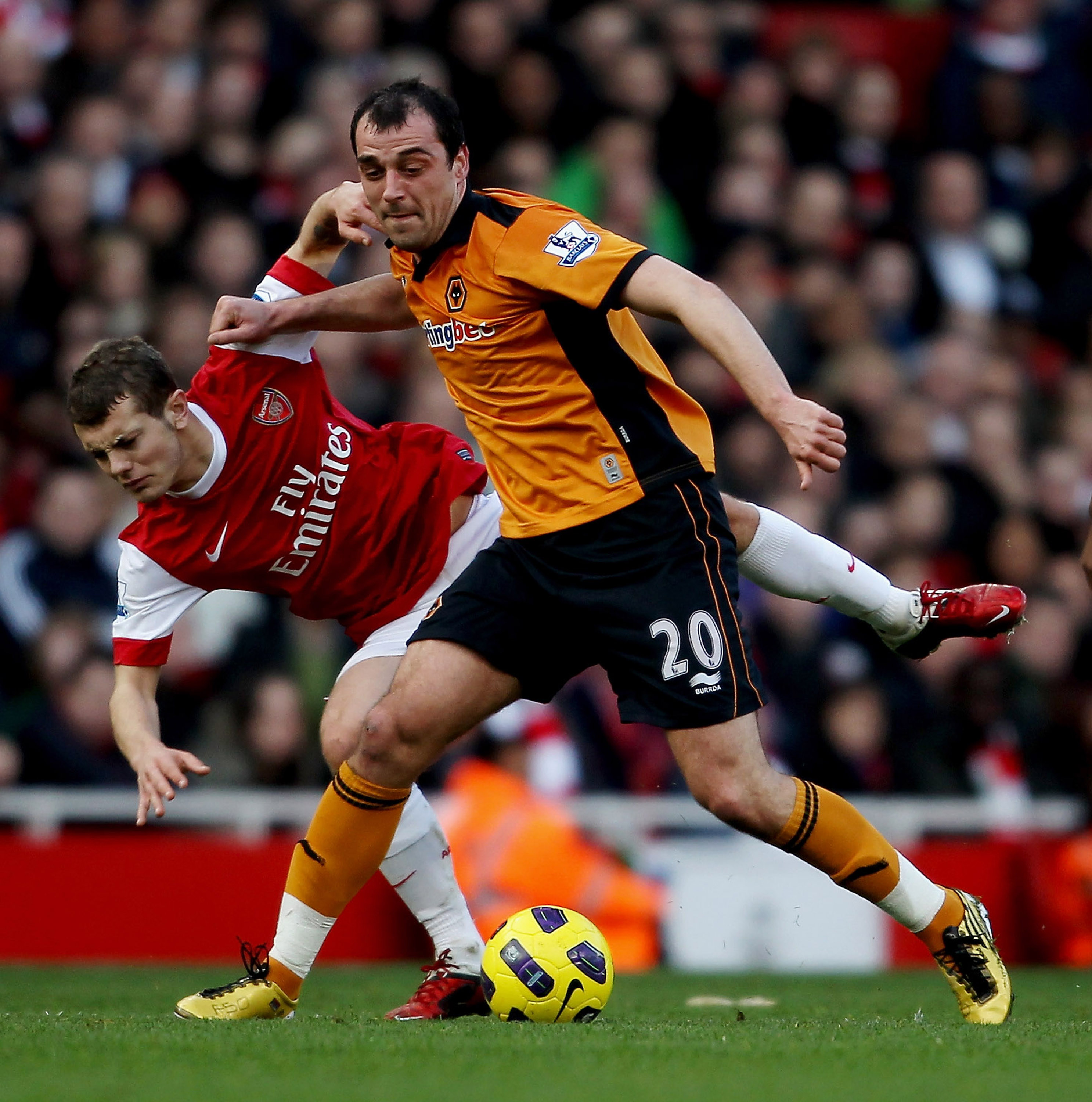 LONDON, ENGLAND - FEBRUARY 12:  Nenad Milijas of Wolves (R) holds off Jack Wilshere of Arsenal during the Barclays Premier League match between Arsenal and Wolverhampton Wanderers on February 12, 2011 in London, England.  (Photo by Scott Heavey/Getty Imag