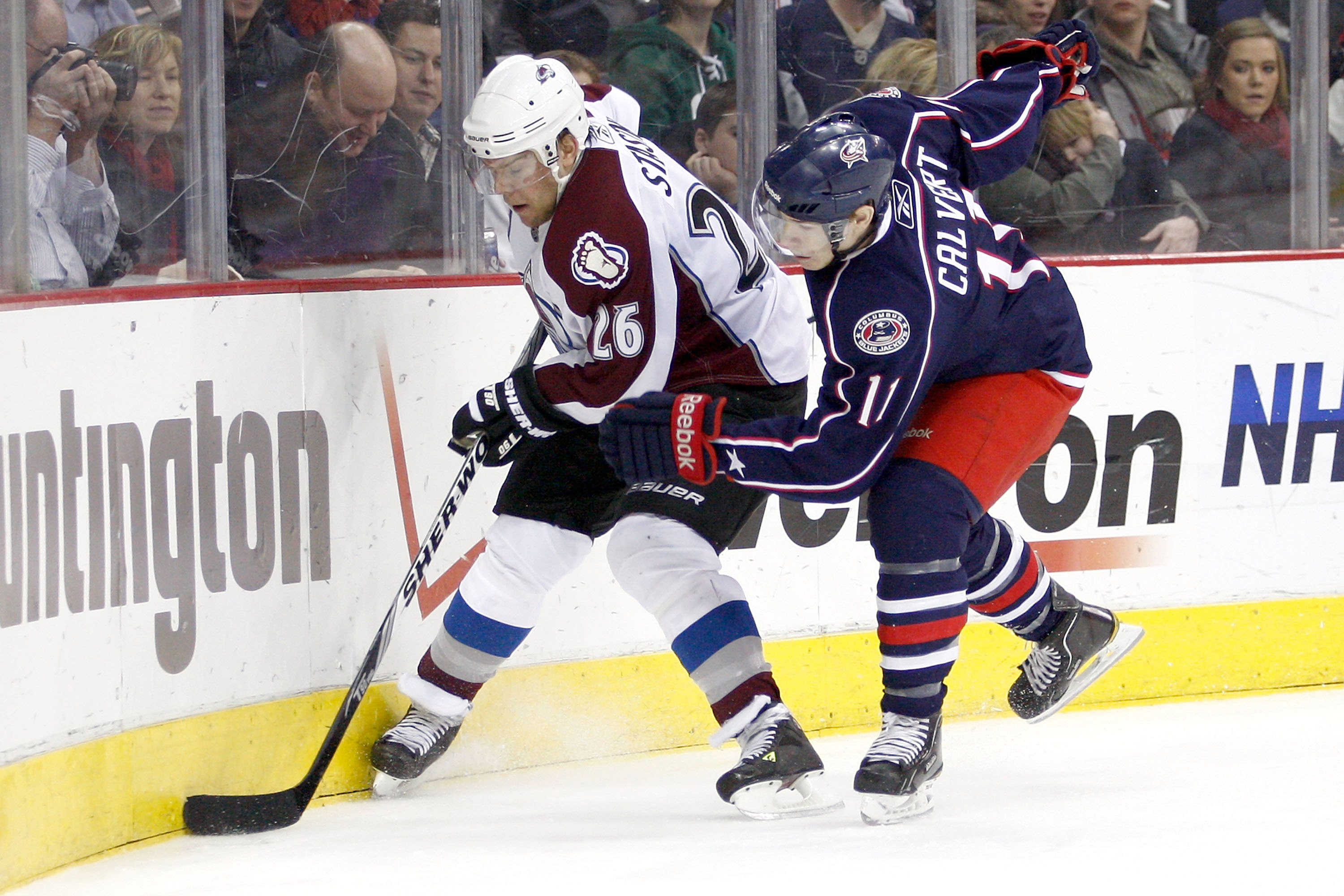 COLUMBUS, OH - FEBRUARY 11:  Paul Stastny #26 of the Colorado Avalanche is checked by Matt Calvert #11 of the Columbus Blue Jackets on February 11, 2011 at Nationwide Arena in Columbus, Ohio. (Photo by John Grieshop/Getty Images)