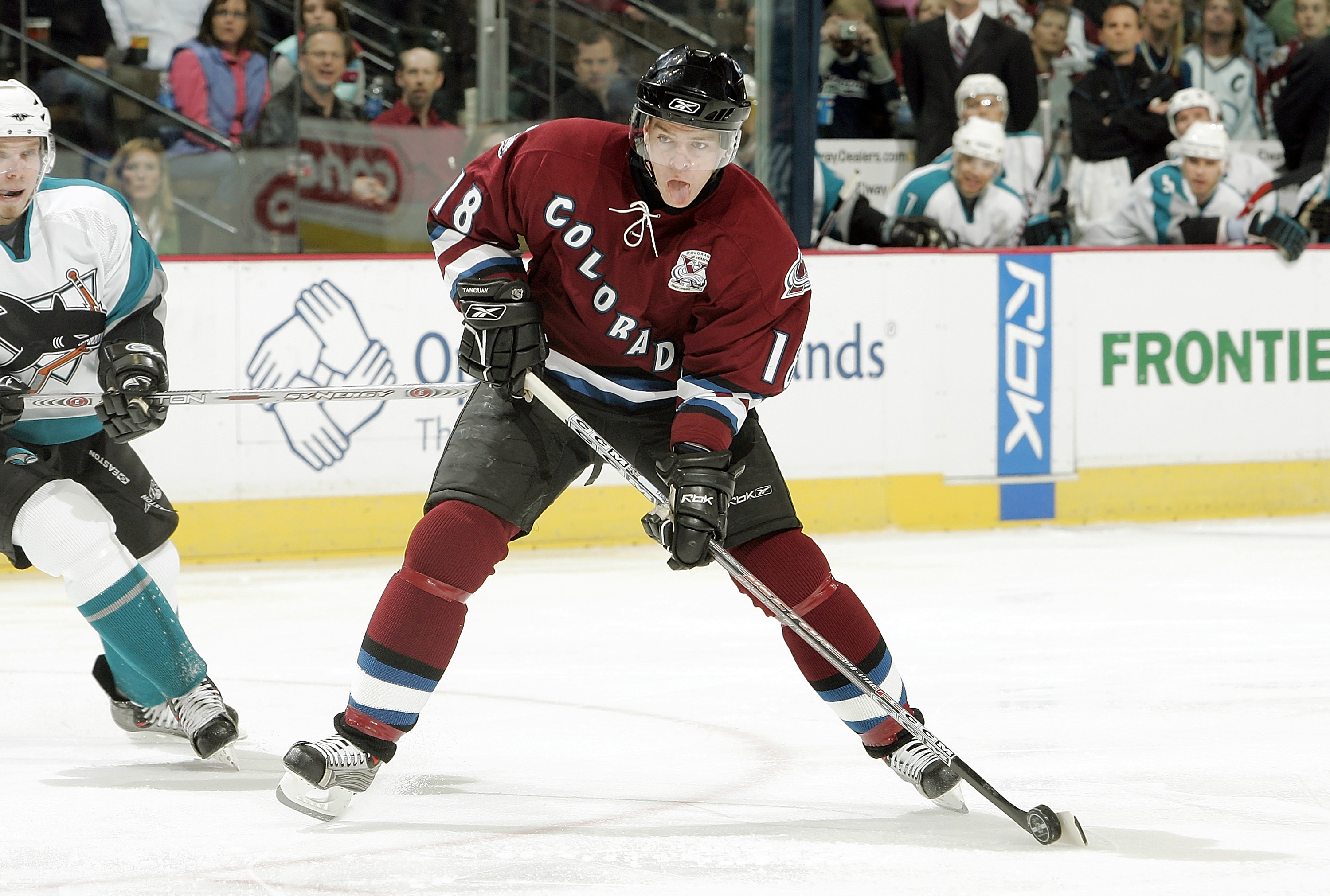DENVER - NOVEMBER 8:  Alex Tanguay #18 of the Colorado Avalanche scores against the San Jose Sharks in the first period on November 8, 2005 at the Pepsi Center in Denver, Colorado.  (Photo by Brian Bahr/Getty Images)