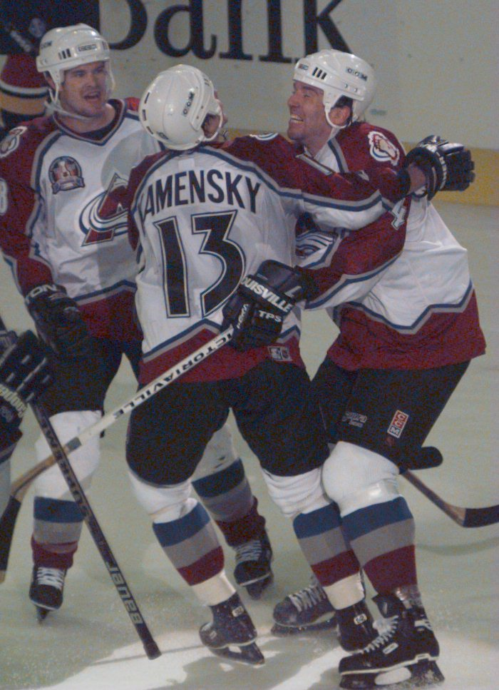 4 Jun 1996:  Defenseman Uwe Krupp (left) of the Colorado Avalanche celebrates with teammates Valeri Kamensky #13 and Adam Deadmarsh after scoring the team''s third goal in the second period during game one of the Stanley Cup Finals at McNichols Arena inDe