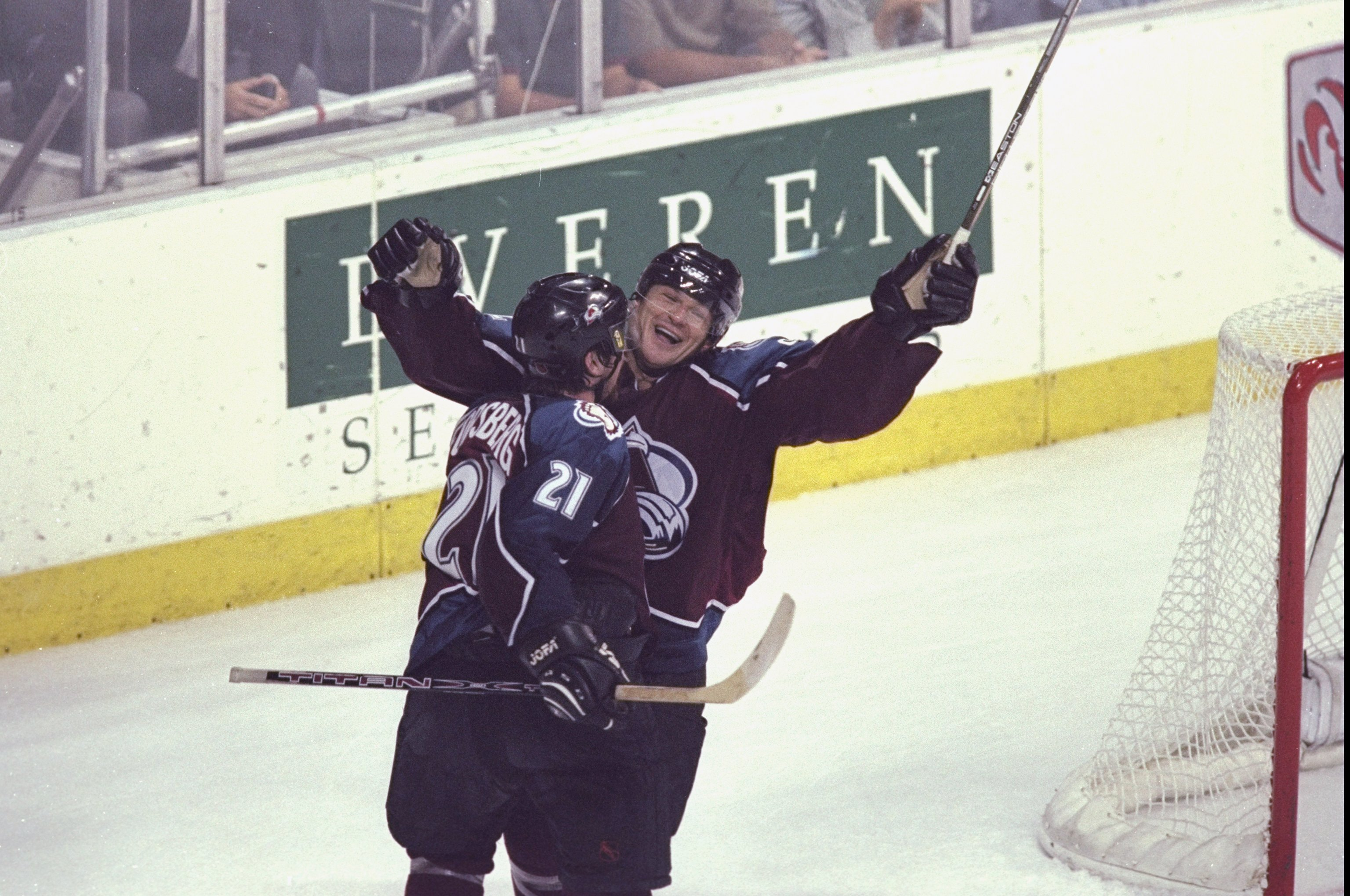 30 May 1999: Peter Forsberg #21of the Colorado Avalanche hugs teammate Claude Lemieux #22 during game five of the Western Confrence Finals against the Dallas Stars at the Reunion Arena in Dallas, Texas. The Avalanche defeated the Stars 7-5. Mandatory Cred