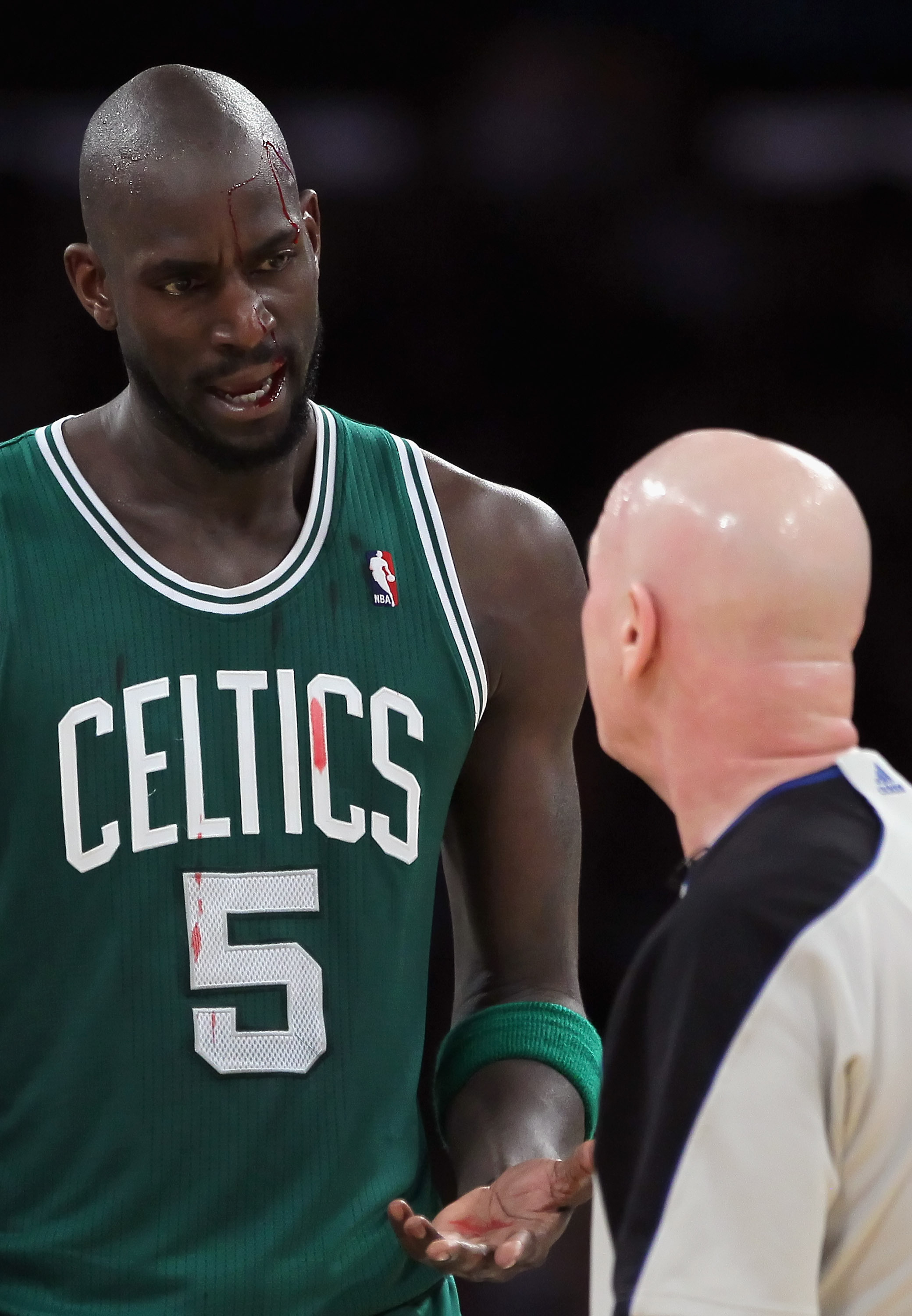LOS ANGELES, CA - JANUARY 30:  Kevin Garnett #5 of the Boston Celtics talks with referee Joe Crawford after being cut above his left eye against the Los Angeles Lakers in the first half at Staples Center on January 30, 2011 in Los Angeles, California. The