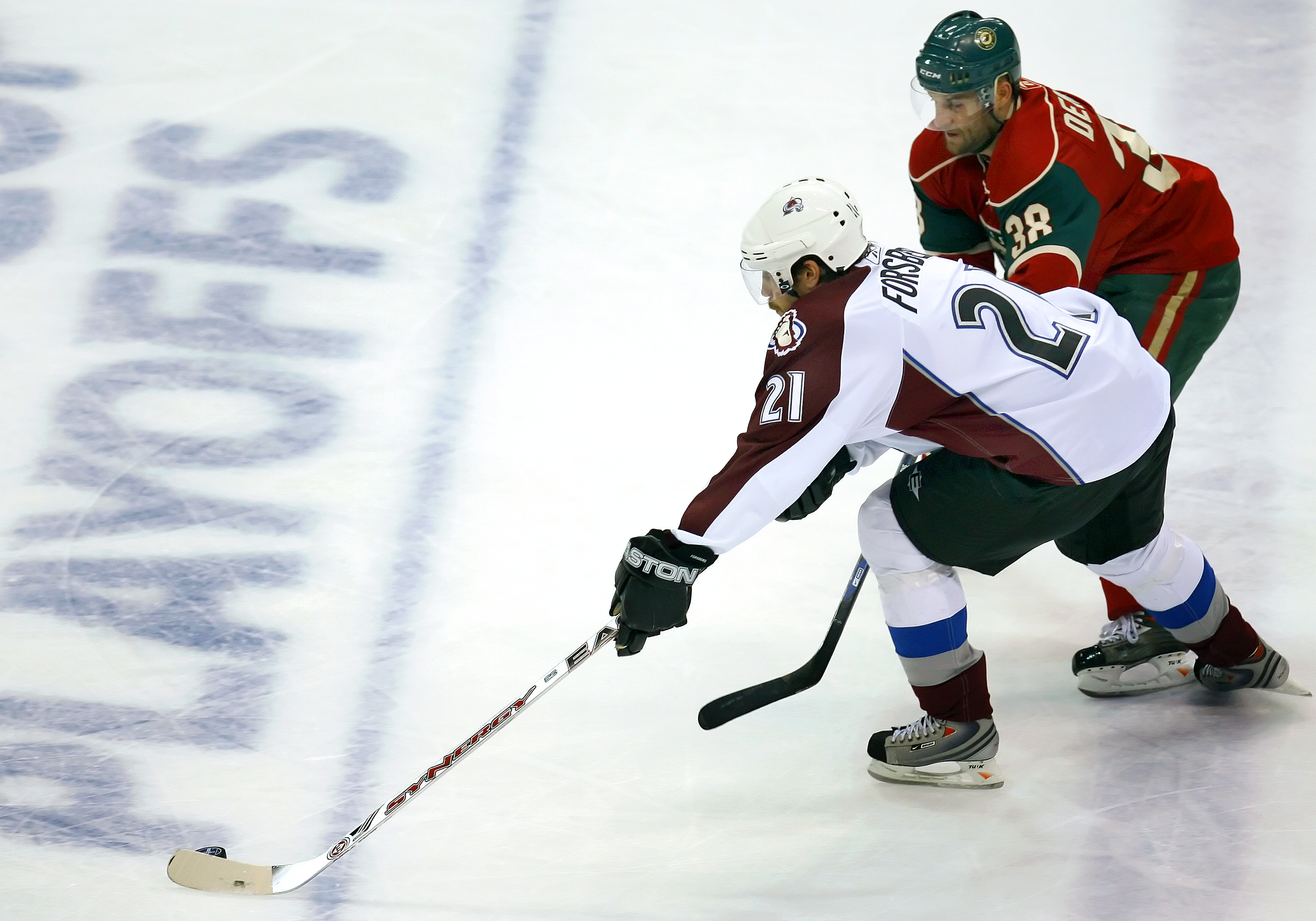 ST. PAUL, MN - APRIL 11:   Peter Forsberg #21 of the Colorado Avalanche tries to skate past Pavol Demitra #38 of the Minnesota Wild during game two of the 2008 NHL Western Conference Quarterfinals on April 11, 2008 at the Xcel Energy Center in St. Paul, M