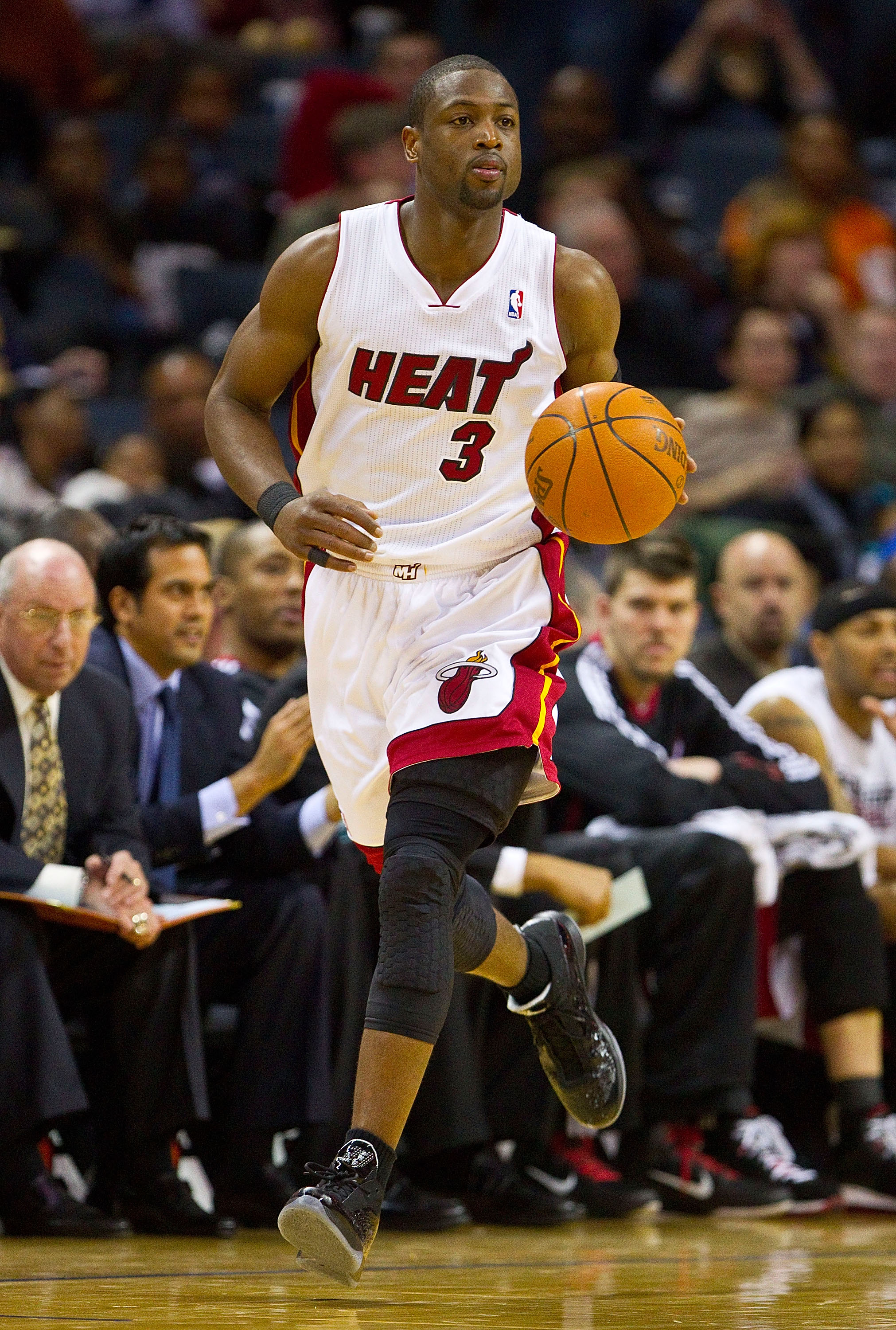 CHARLOTTE, NC - FEBRUARY 04:   Dwyane Wade #3 of the Miami Heat dribbles the ball up court against the Charlotte Bobcats at the Time Warner Cable Arena on February 4, 2011 in Charlotte, North Carolina.  The Heat defeated the Bobcats 109-97.  NOTE TO USER: