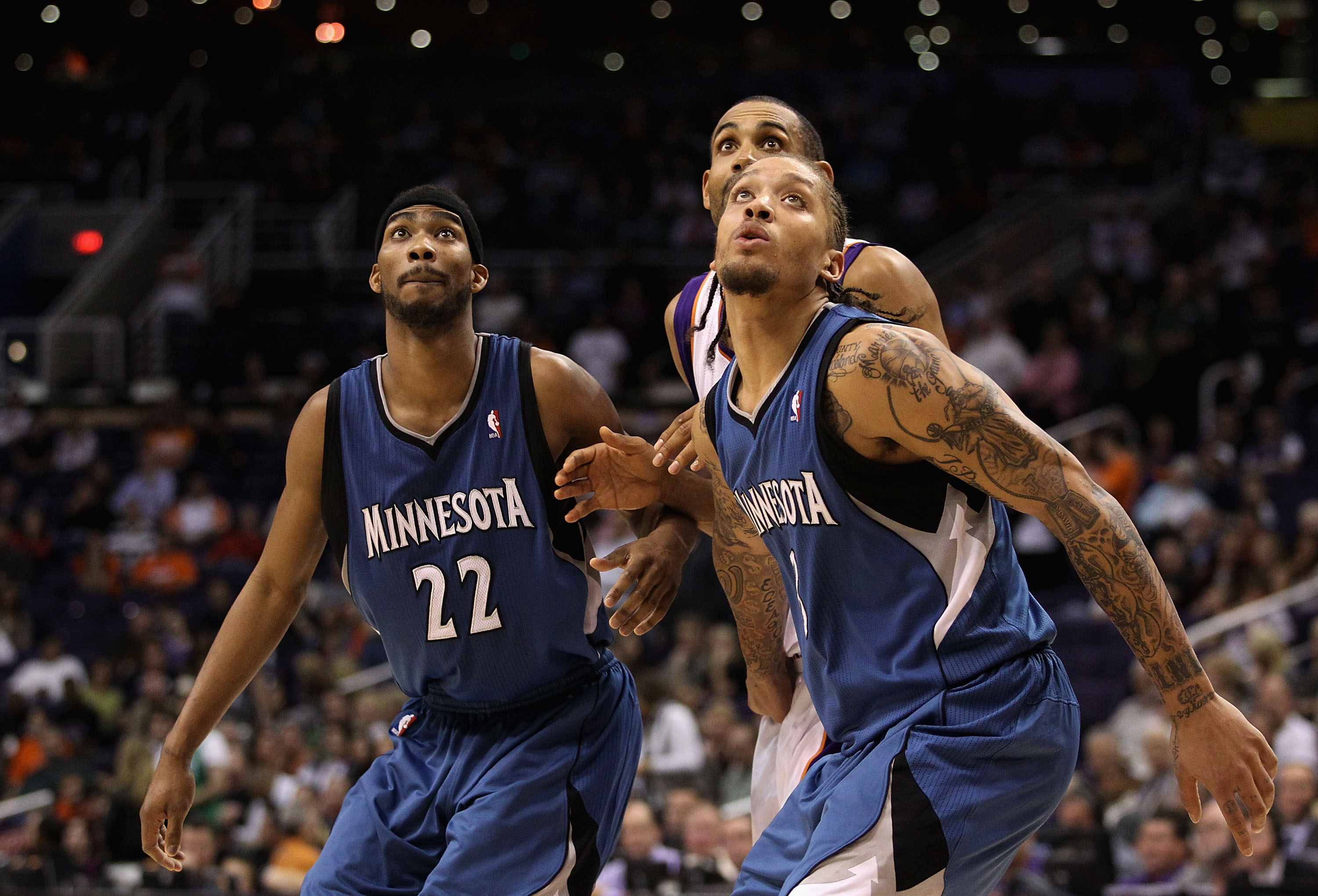 PHOENIX - DECEMBER 15:  Corey Brewer #22 and Michael Beasley #22 of the Minnesota Timberwolves block out Grant Hill #33 of the Phoenix Suns during the NBA game at US Airways Center on December 15, 2010 in Phoenix, Arizona.  The Suns defeated the Timberwol