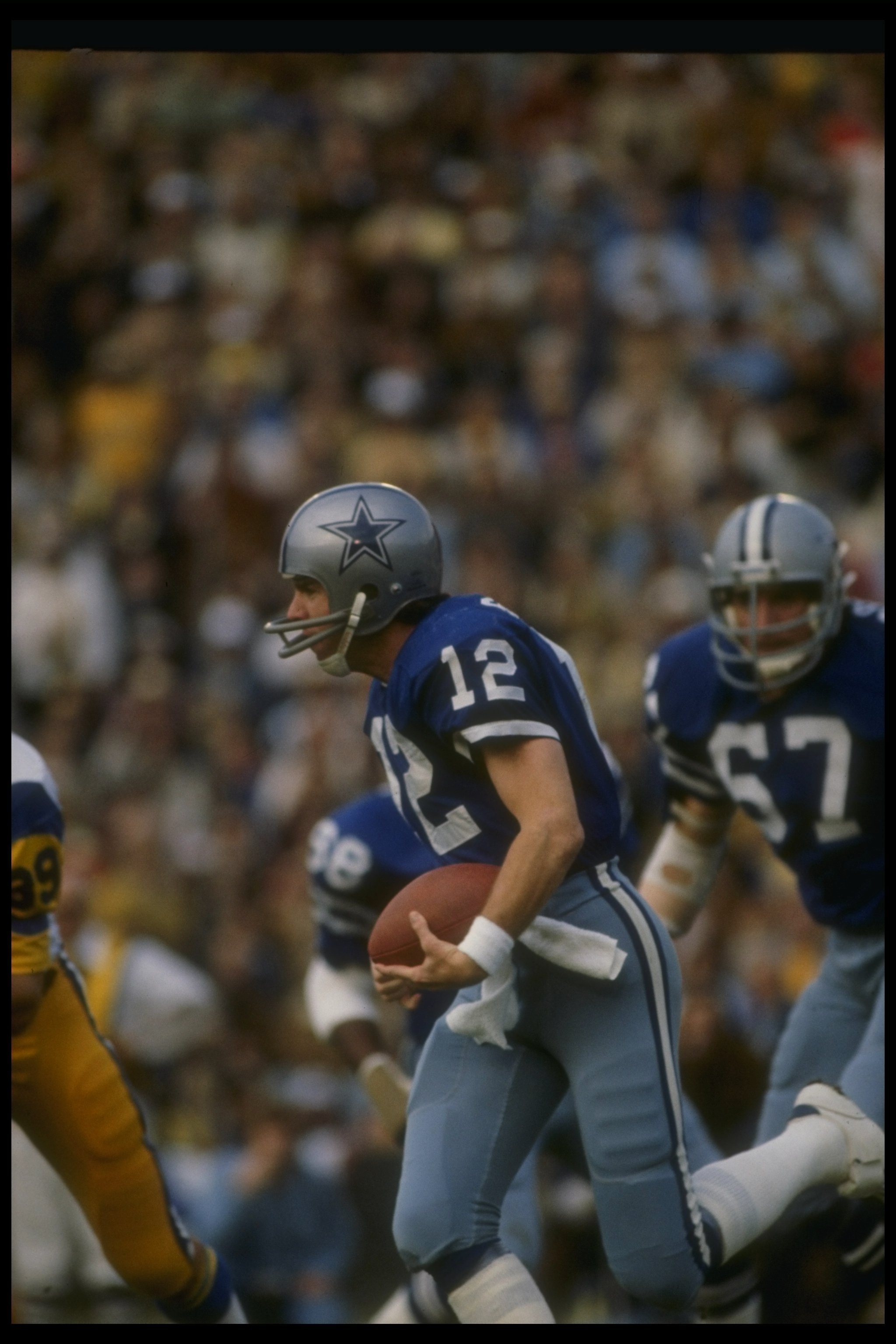 7 Jan 1979:  Quarterback Roger Staubach of the Dallas Cowboys moves the ball during a playoff game against the Los Angeles Rams at Anaheim Stadium in Anaheim, California.  The Cowboys won the game, 28-0. Mandatory Credit: Allsport  /Allsport