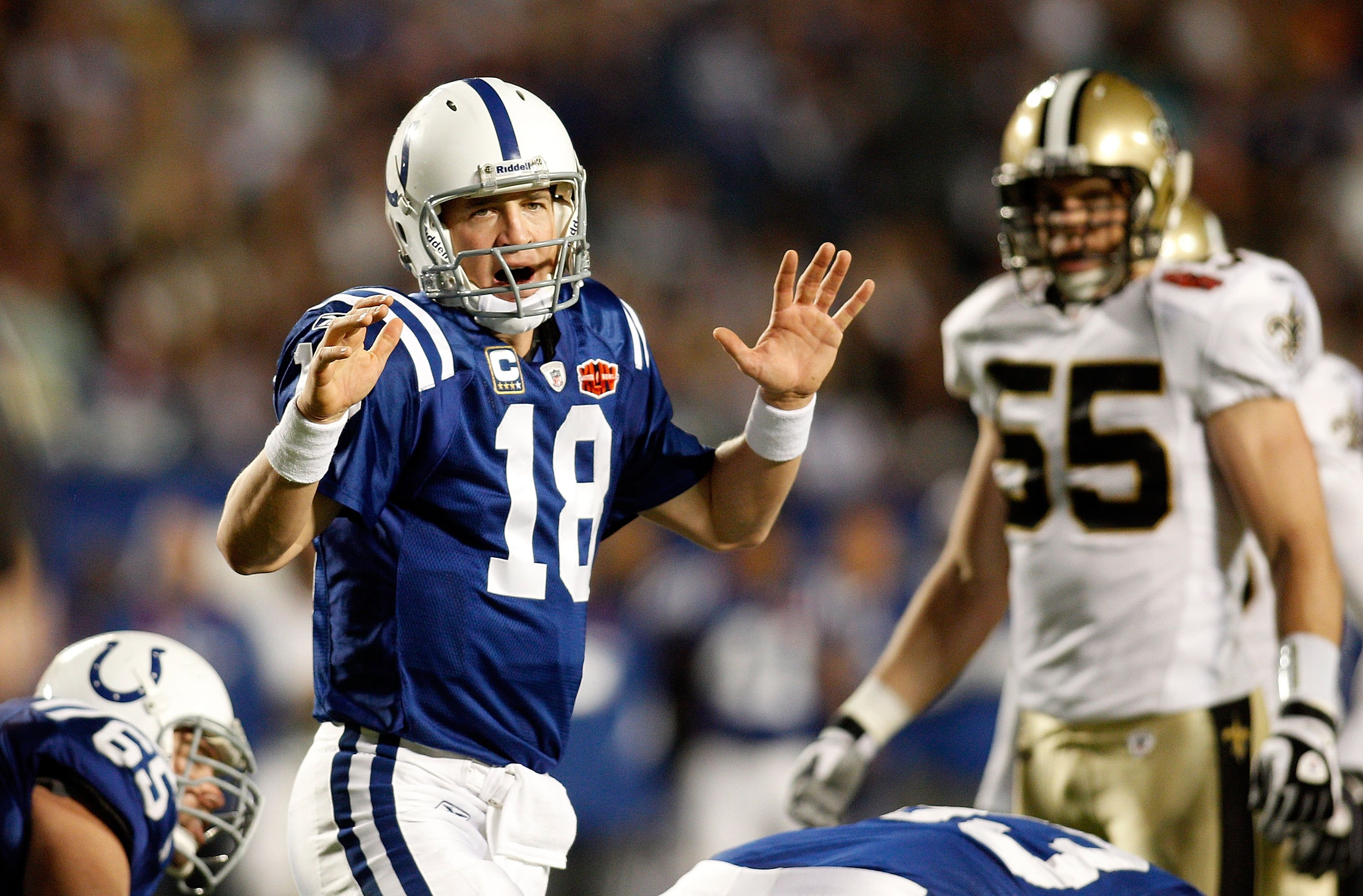 MIAMI GARDENS, FL - FEBRUARY 07:  Quarterback Peyton Manning #18 of the Indianapolis Colts calls a play against the New Orleans Saints during Super Bowl XLIV on February 7, 2010 at Sun Life Stadium in Miami Gardens, Florida.  (Photo by Chris Graythen/Gett