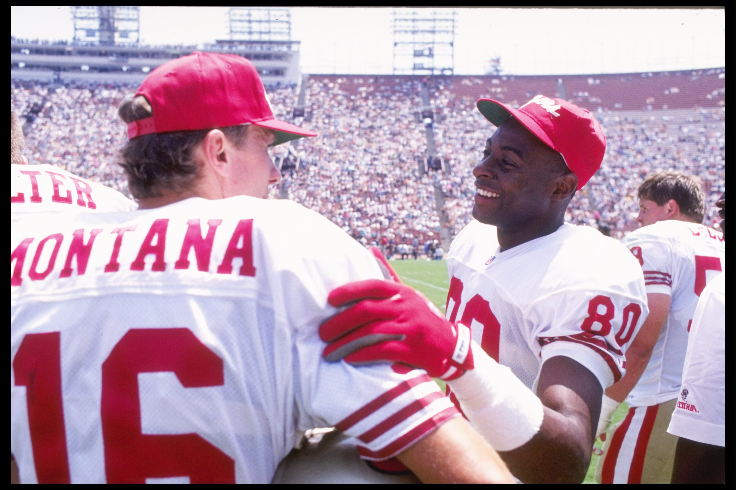 27 Jul 1991:  Quarterback Joe Montana and wide receiver Jerry Rice of the San Francisco 49ers talk to each other during a preseason game against the Los Angeles Raiders.  The 49ers won the game 24-17. Mandatory Credit: Stephen Dunn  /Allsport