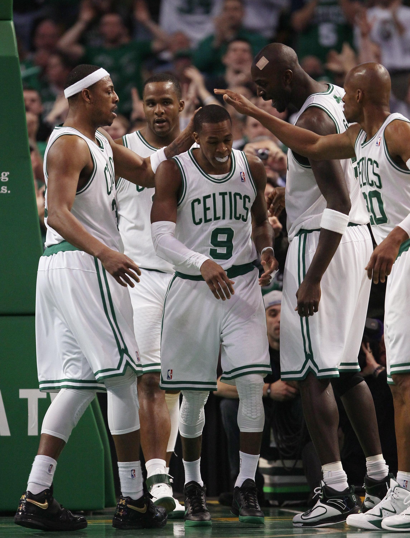 BOSTON, MA - FEBRUARY 06:  Rajon Rondo #9 of the Boston Celtics is congratulated by teammates Paul Pierce #23,Glen Davis #11,Kevin Garnett #5 and Ray Allen #20 after Rondo drew the foul in the second half agianst the Orlando Magic on February 6, 2011 at t