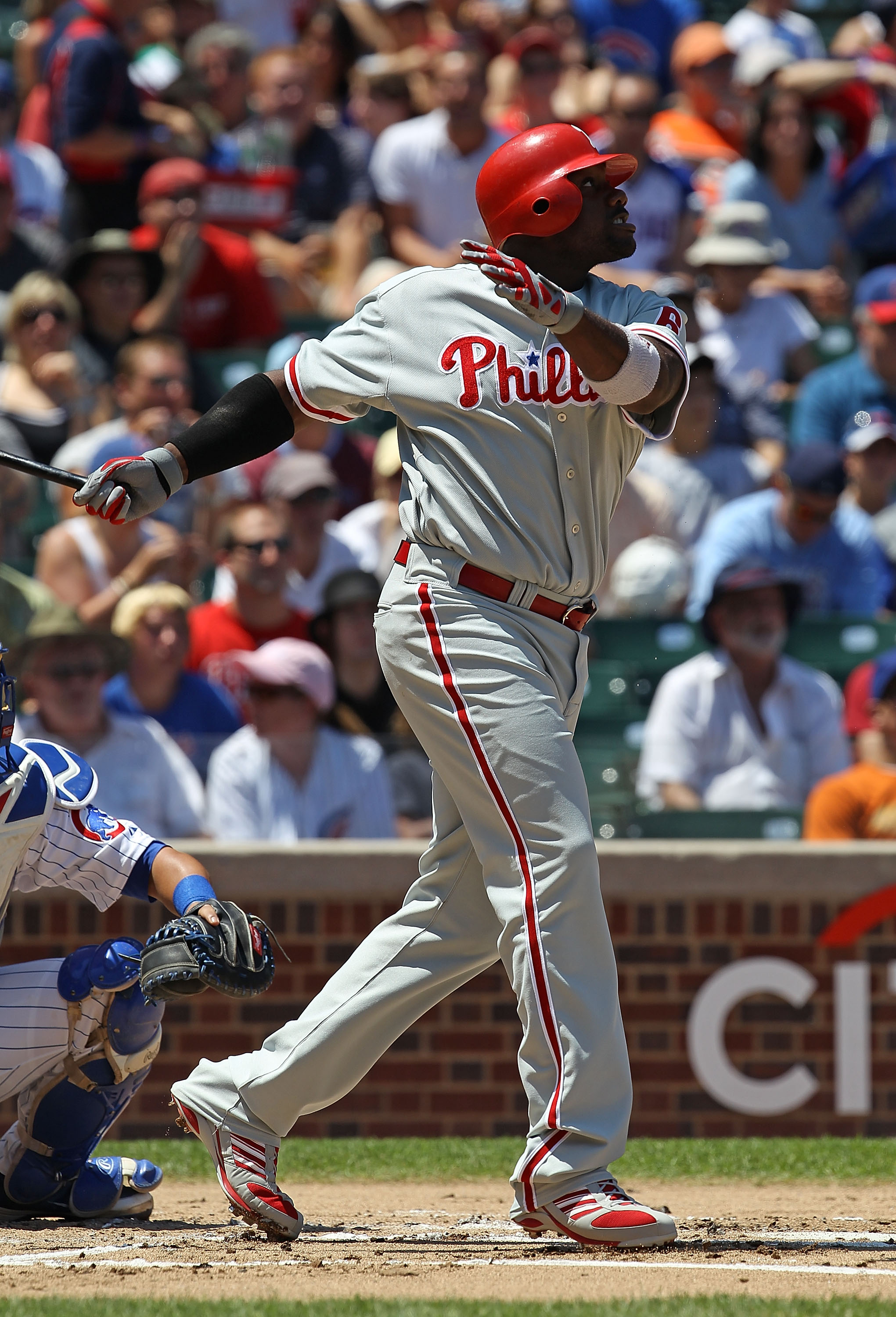 CHICAGO - JULY 16: Ryan Howard #6 of the Philadelphia Phillies watches the flight of the ball against the Chicago Cubs at Wrigley Field on July 16, 2010 in Chicago, Illinois. The Cubs defeated the Phillies 4-3. (Photo by Jonathan Daniel/Getty Images)