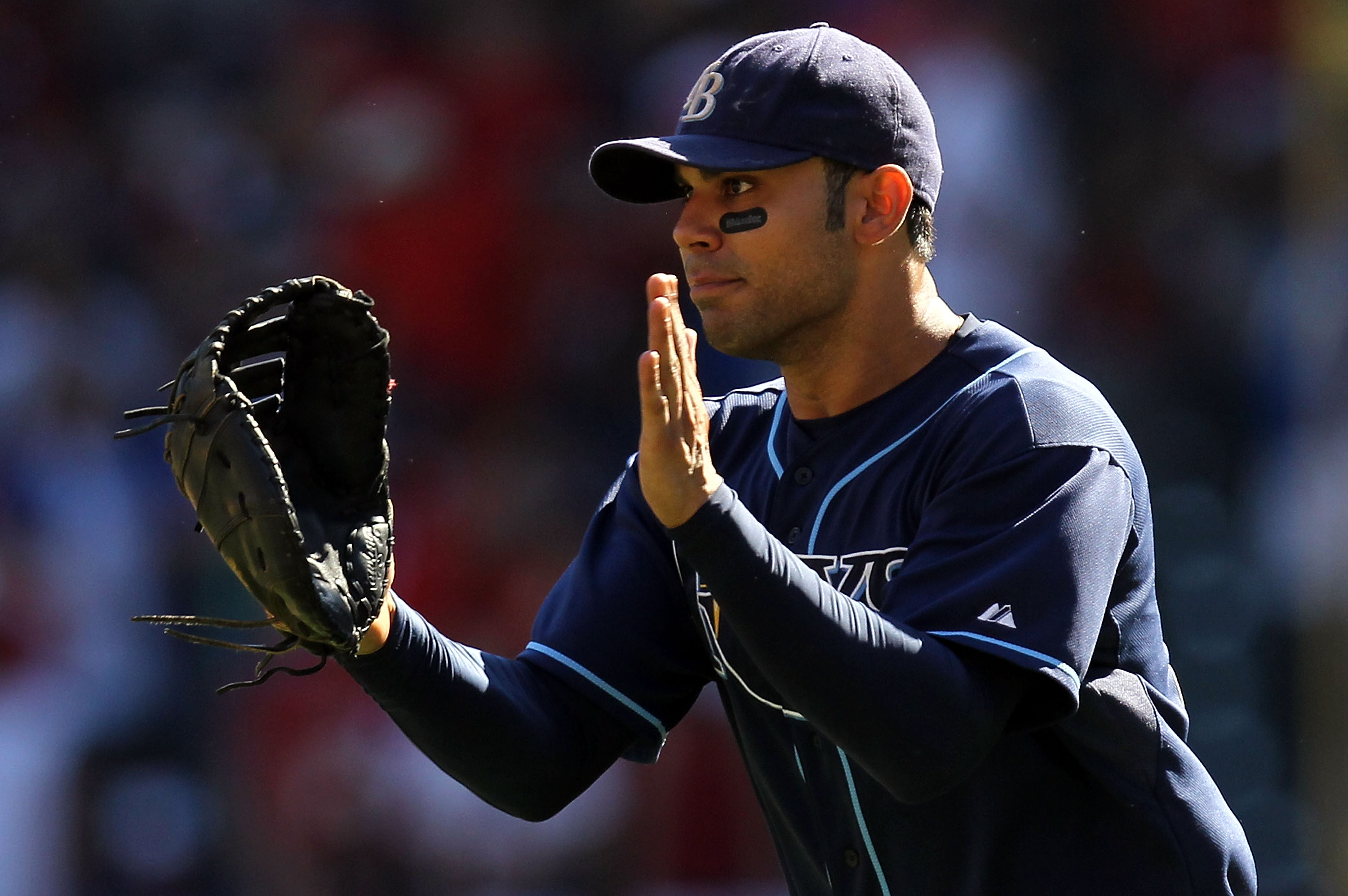 ARLINGTON, TX - OCTOBER 10:  Carlos Pena #23 of the Tampa Bay Rays celebrates after a 5-2 win against the Texas Rangers during game 4 of the ALDS at Rangers Ballpark in Arlington on October 10, 2010 in Arlington, Texas.  (Photo by Ronald Martinez/Getty Im