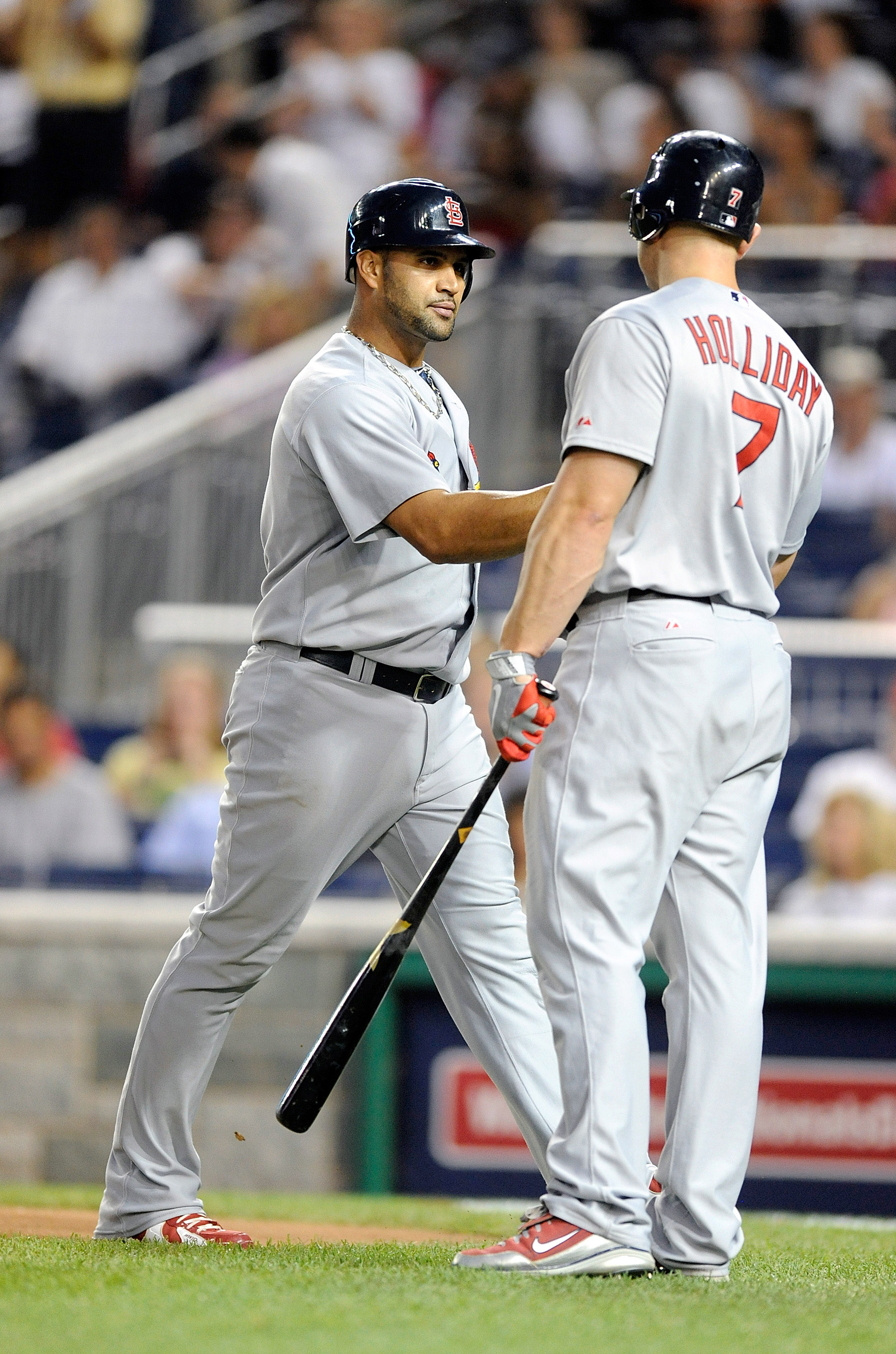 WASHINGTON - AUGUST 26:  Albert Pujols #5 of the St. Louis Cardinals is congratulated by Matt Holliday #7 after hitting a home run in the fourth inning against the Washington Nationals at Nationals Park on August 26, 2010 in Washington, DC. It was the 400