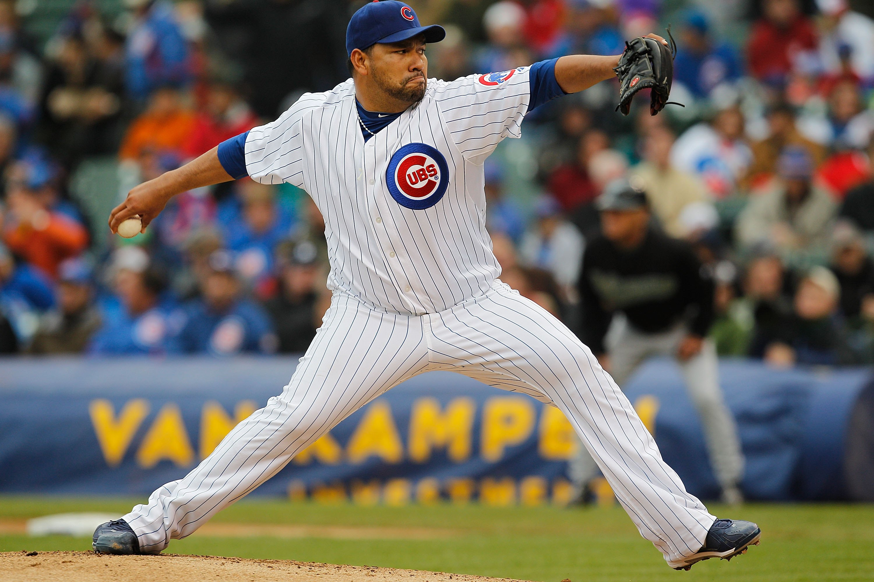 CHICAGO - MAY 12: Starting pitcher Carlos Silva #52 of the Chicago Cubs delivers the ball against the Florida Marlins at Wrigley Field on May 12, 2010 in Chicago, Illinois. The Cubs defeated the Marlins 4-3.  (Photo by Jonathan Daniel/Getty Images)