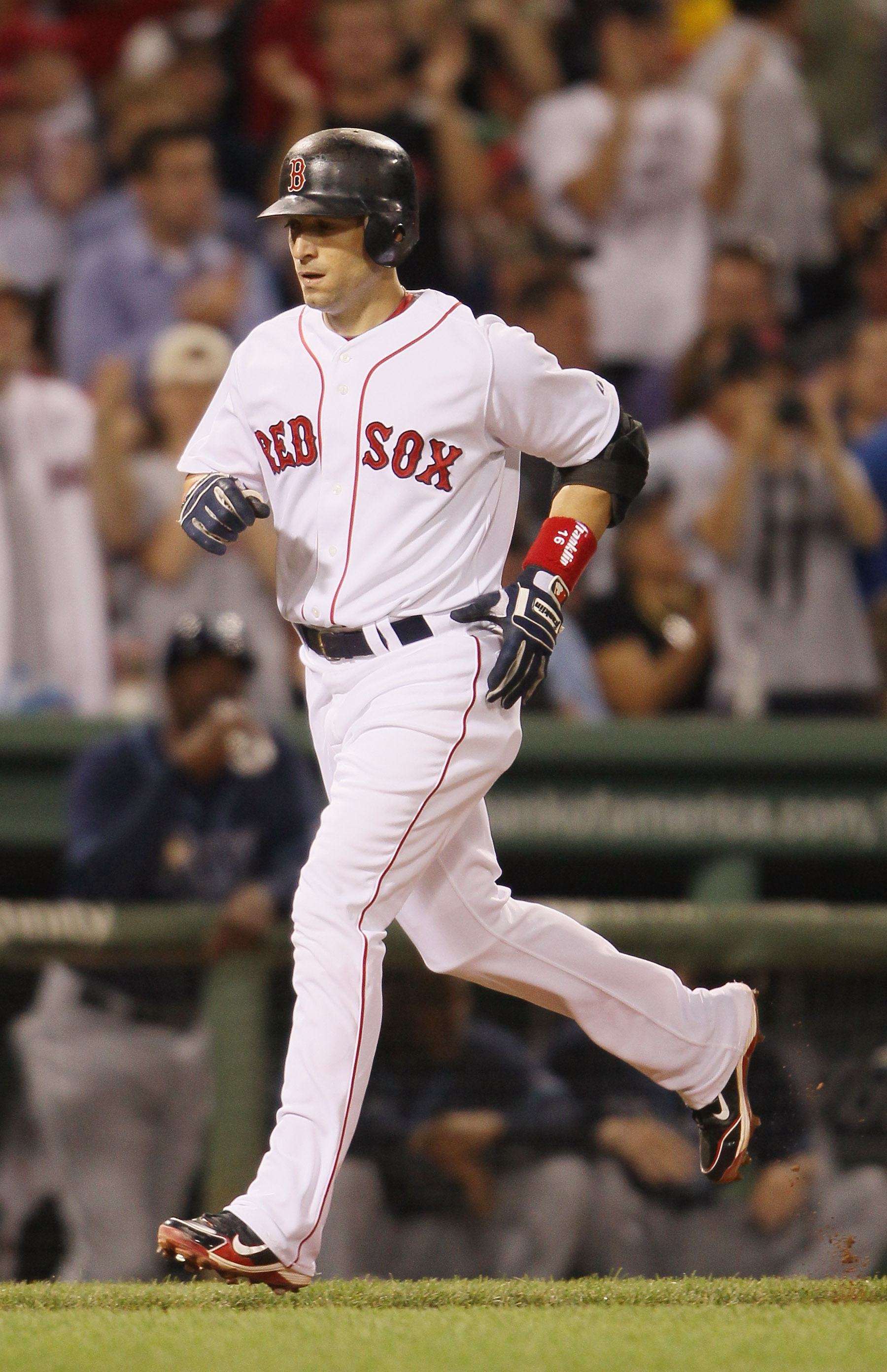 BOSTON - SEPTEMBER 08:  Marco Scutaro #16 of the Boston Red Sox heads for home after he hit a solo home run against the Tampa Bay Rays on September 8, 2010 at Fenway Park in Boston, Massachusetts.  (Photo by Elsa/Getty Images)
