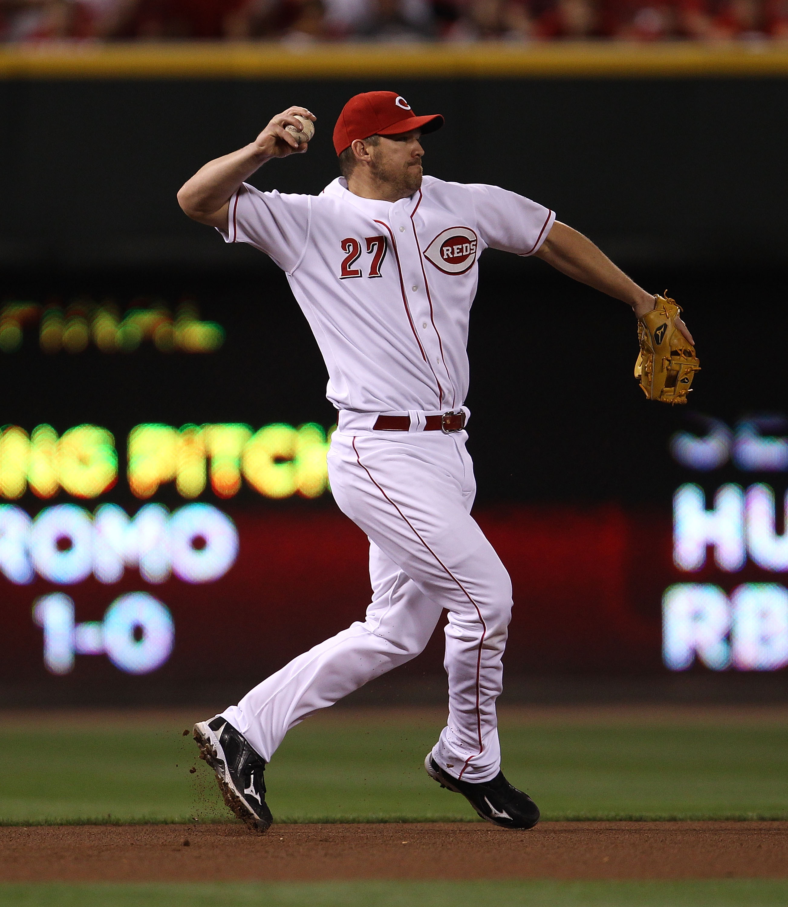 CINCINNATI - OCTOBER 10: Scott Rolen #27 of the Cincinnati Reds throws to 2nd base against the Philadelphia Phillies during game 3 of the NLDS at Great American Ball Park on October 10, 2010 in Cincinnati, Ohio. The Phillies defeated the Reds 2-0.  (Photo