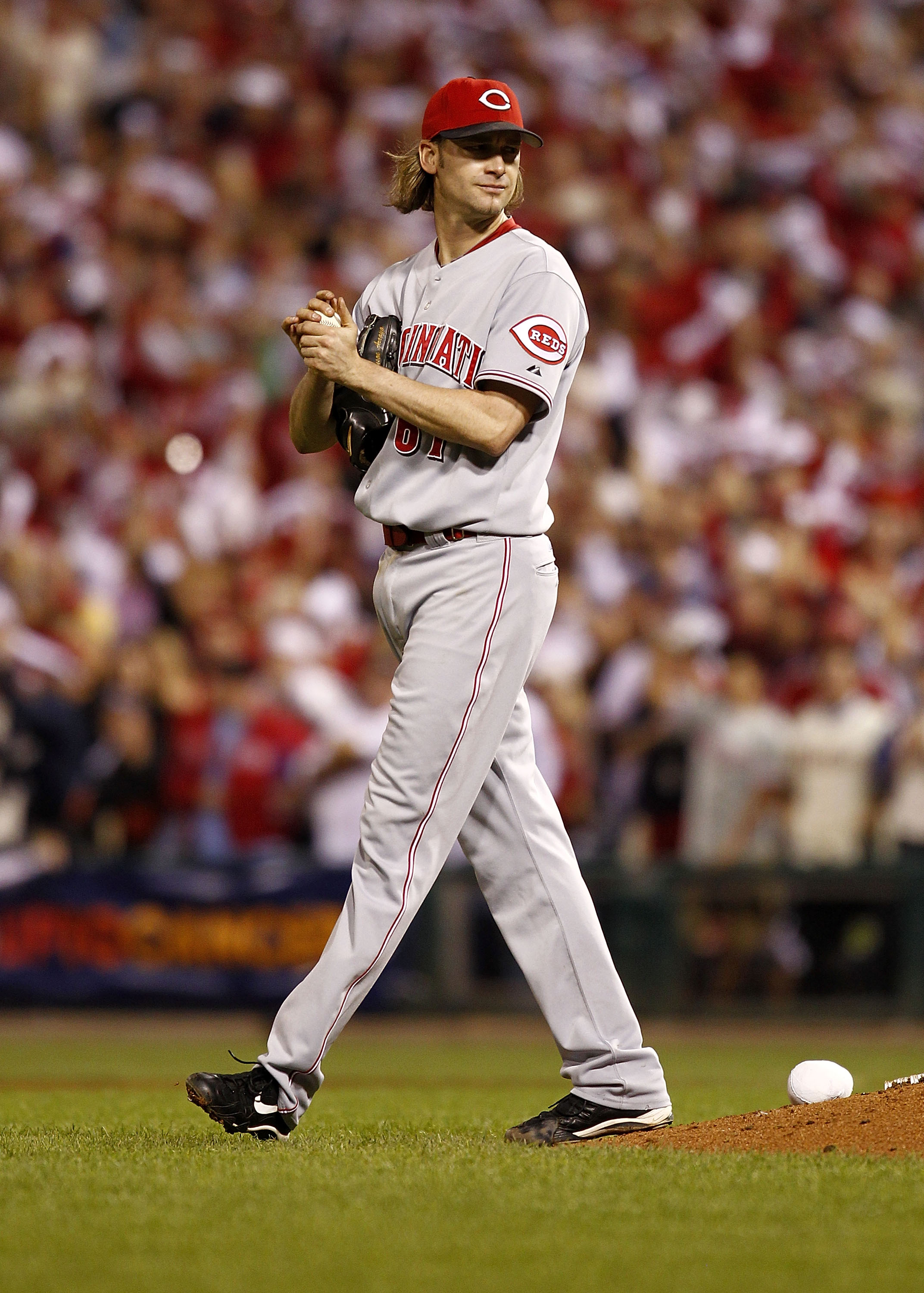 PHILADELPHIA - OCTOBER 08:  Bronson Arroyo #61 of the Cincinnati Reds walks to the mound in Game 2 of the NLDS against the Philadelphia Phillies at Citizens Bank Park on October 8, 2010 in Philadelphia, Pennsylvania.  (Photo by Jeff Zelevansky/Getty Image