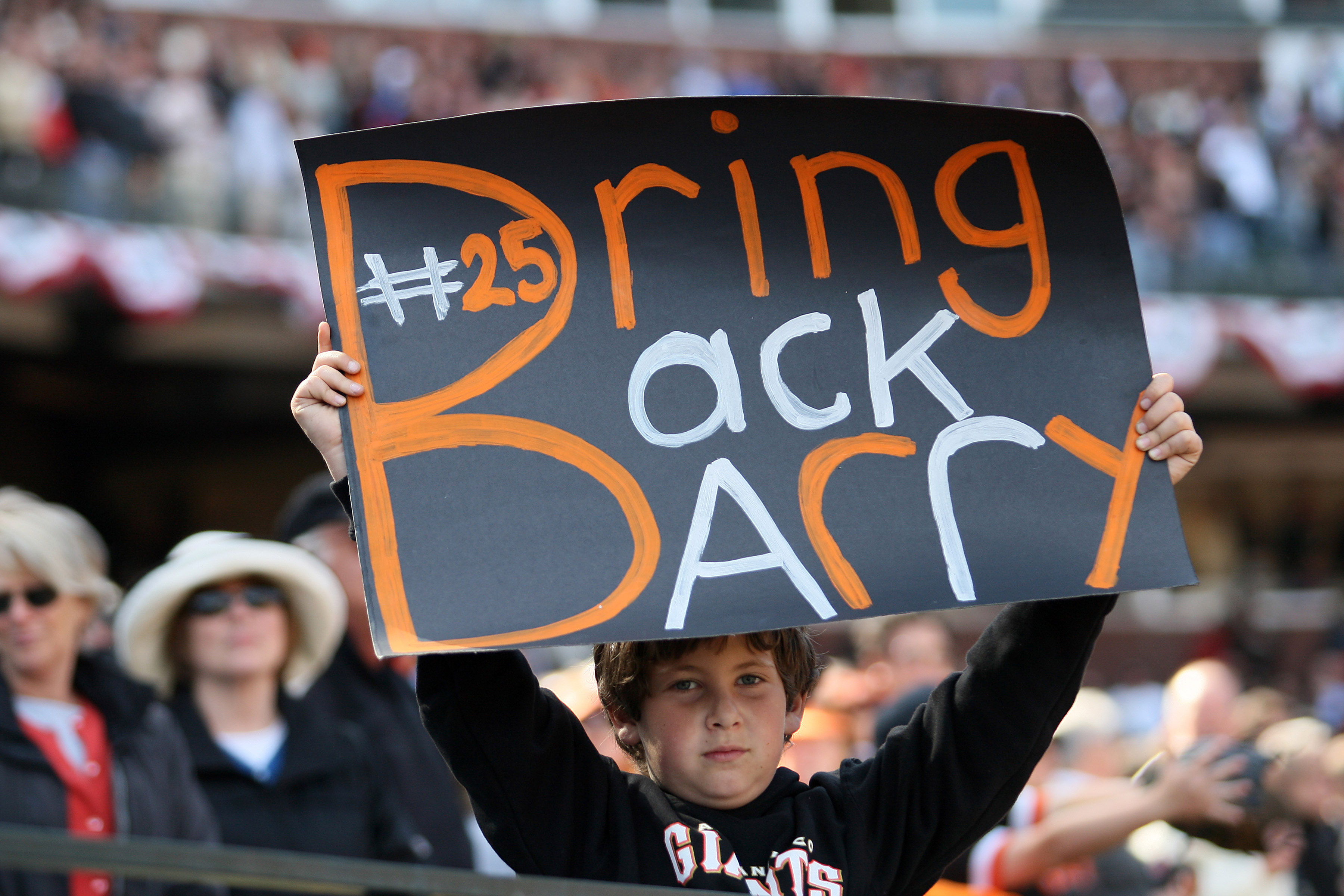 SAN FRANCISCO - APRIL 7:  A young San Francisco Giants fan holds a sign imploring the Giants to Bring Back Barry (Bonds) during the opening day game against the San Diego Padres on April 7, 2008 at AT&T Park in San Francisco, California. The Padres defeat