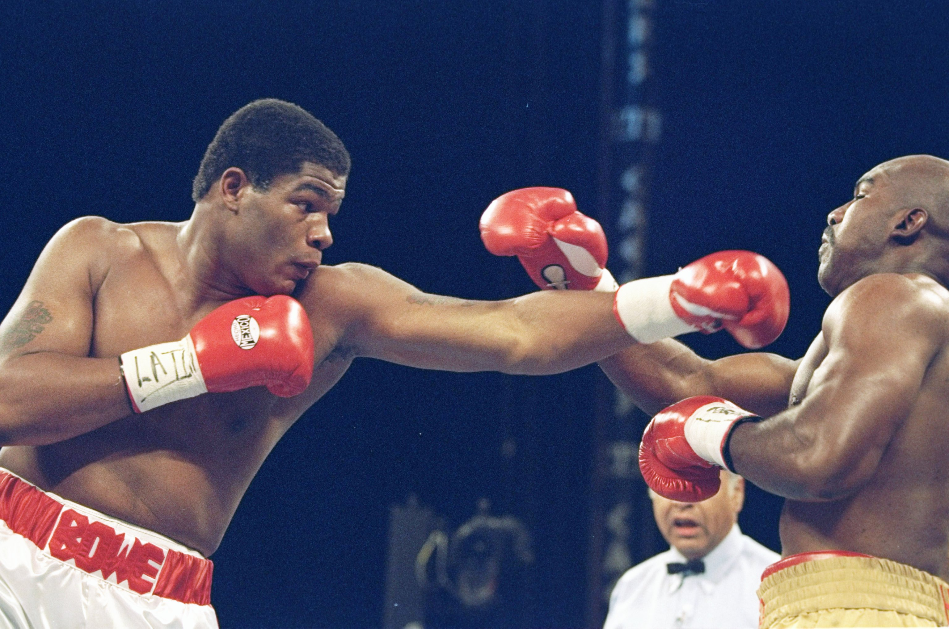 4 Nov 1995:  Riddick Bowe (left) lands a left blow on Evander Holyfield III during a bout at the Caesar Palace in Las Vegas, Nevada.  Riddick Bowe won the fight with a technical knockout in the eigth round.. Mandatory Credit: Al Bello  /Allsport