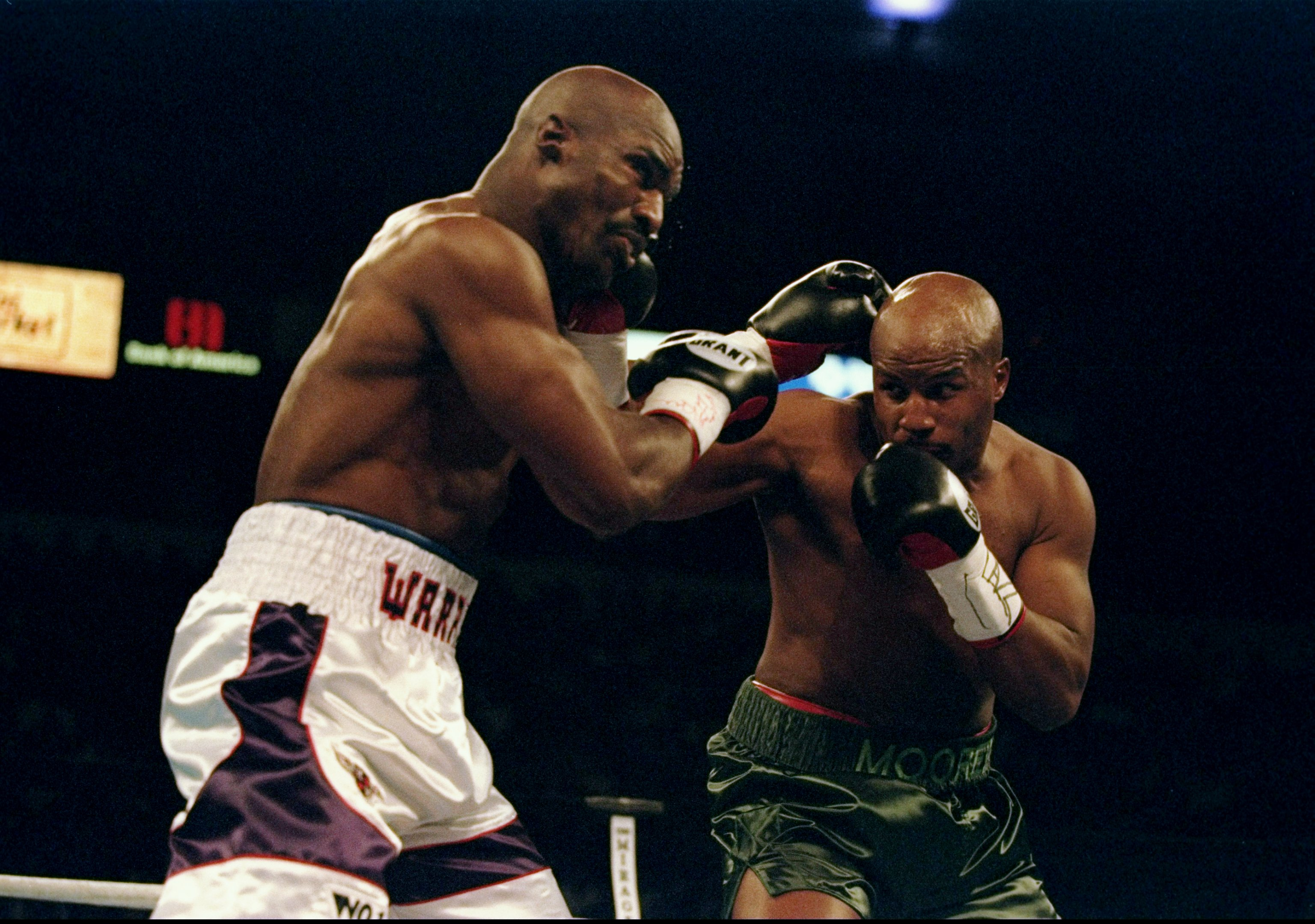 8 Nov 1997:  Michael Moorer and Evander Holyfield throw punches at each other during a fight at the Thomas and Mack Center in Las Vegas, Nevada.  Holyfield won the fight by a technical knockout. Mandatory Credit: Al Bello  /Allsport