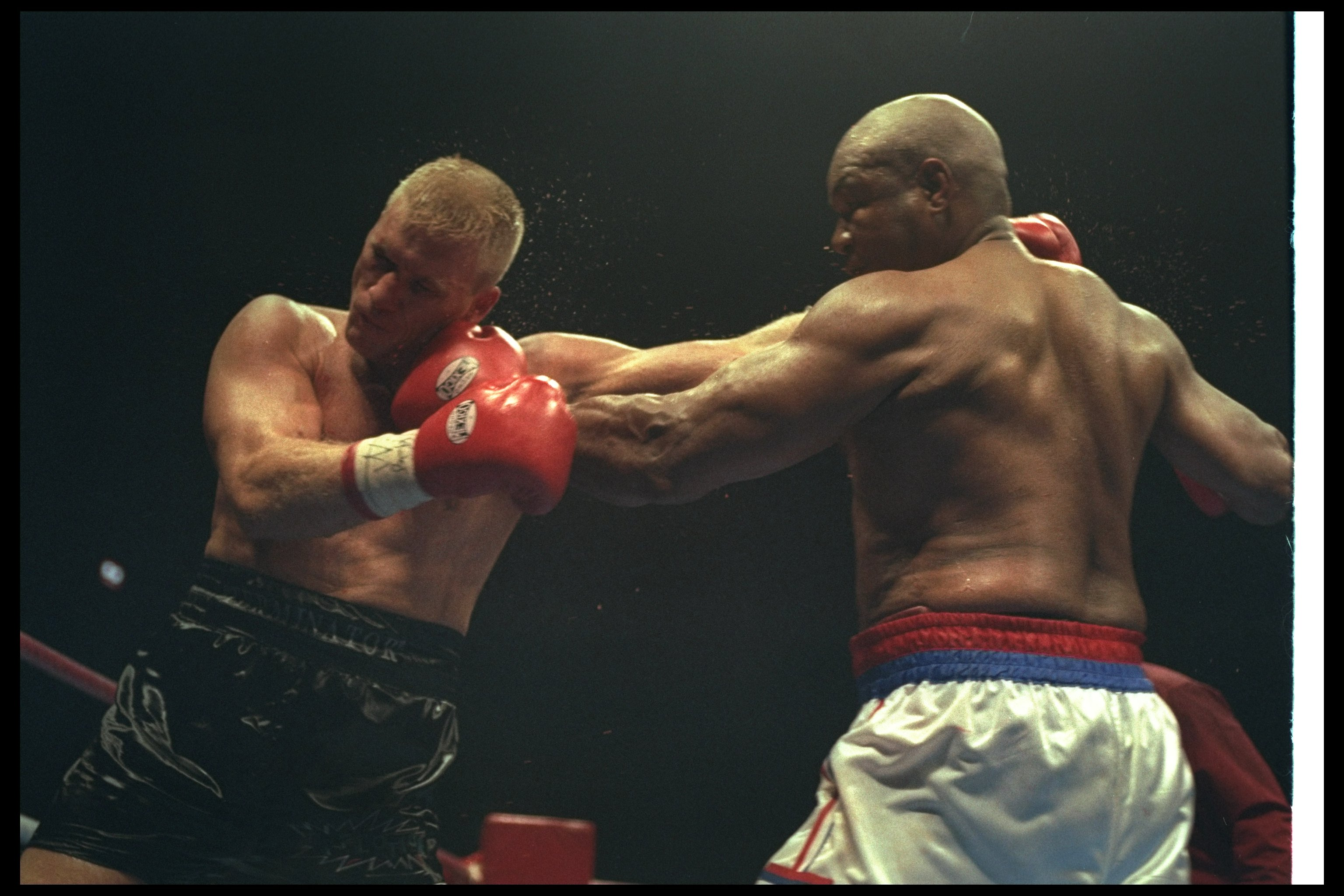 3 Nov 1996:  George Foreman (right) and Crawford Grimsley trade blows during a bout at Tokyo Bay NK Hall in Tokyo, Japan.  Foreman won the fight by a decision in the twelfth round. Mandatory Credit: Al Bello  /Allsport