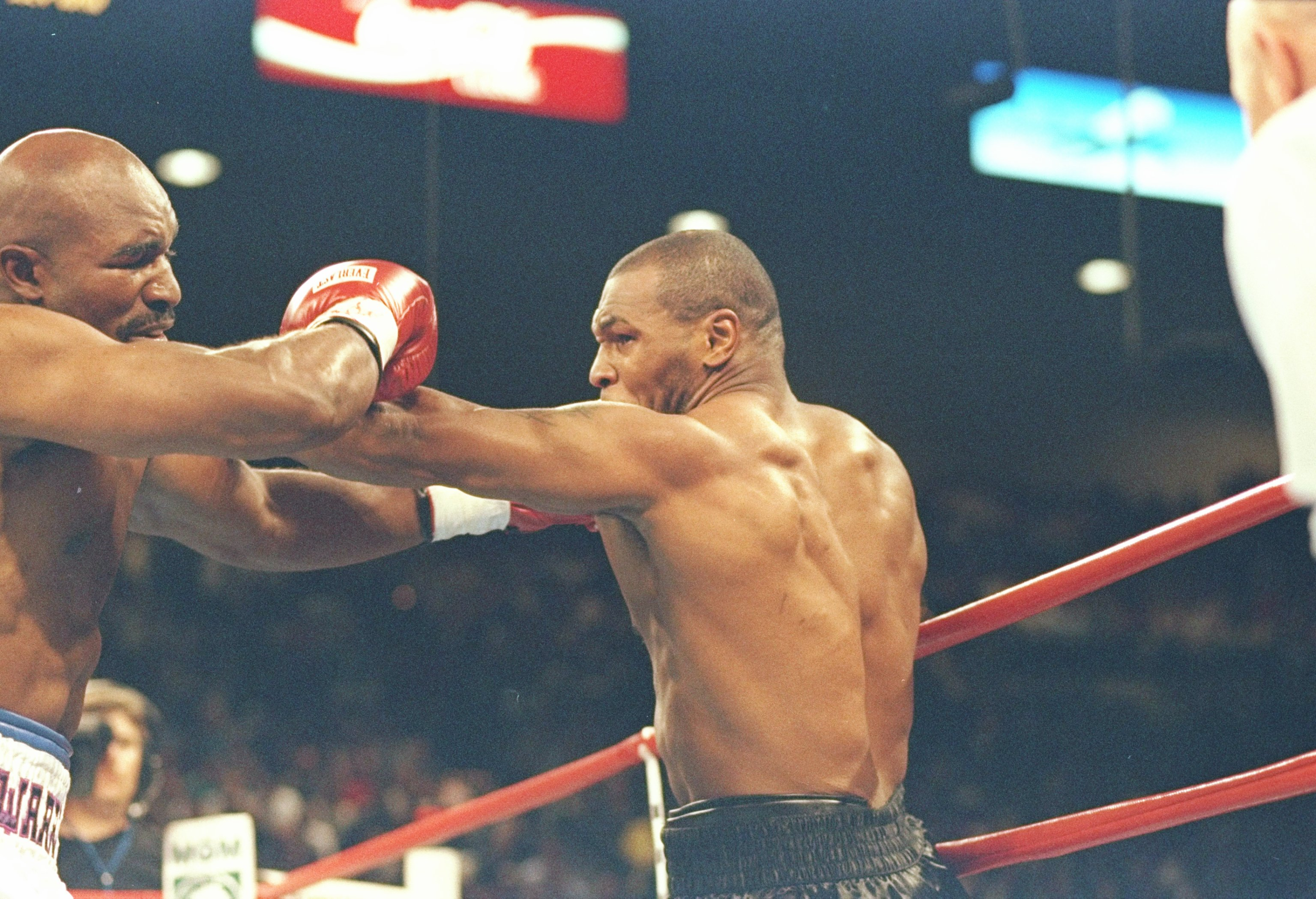 28 Jun 1997:  Mike Tyson (right) and Evander Holyfield square off during their bout at the MGM Grand Garden in Las Vegas, Nevada.  Holyfield won the fight when referee Mills Lane disqualified Tyson in the third round after biting Holyfield twice. Mandator