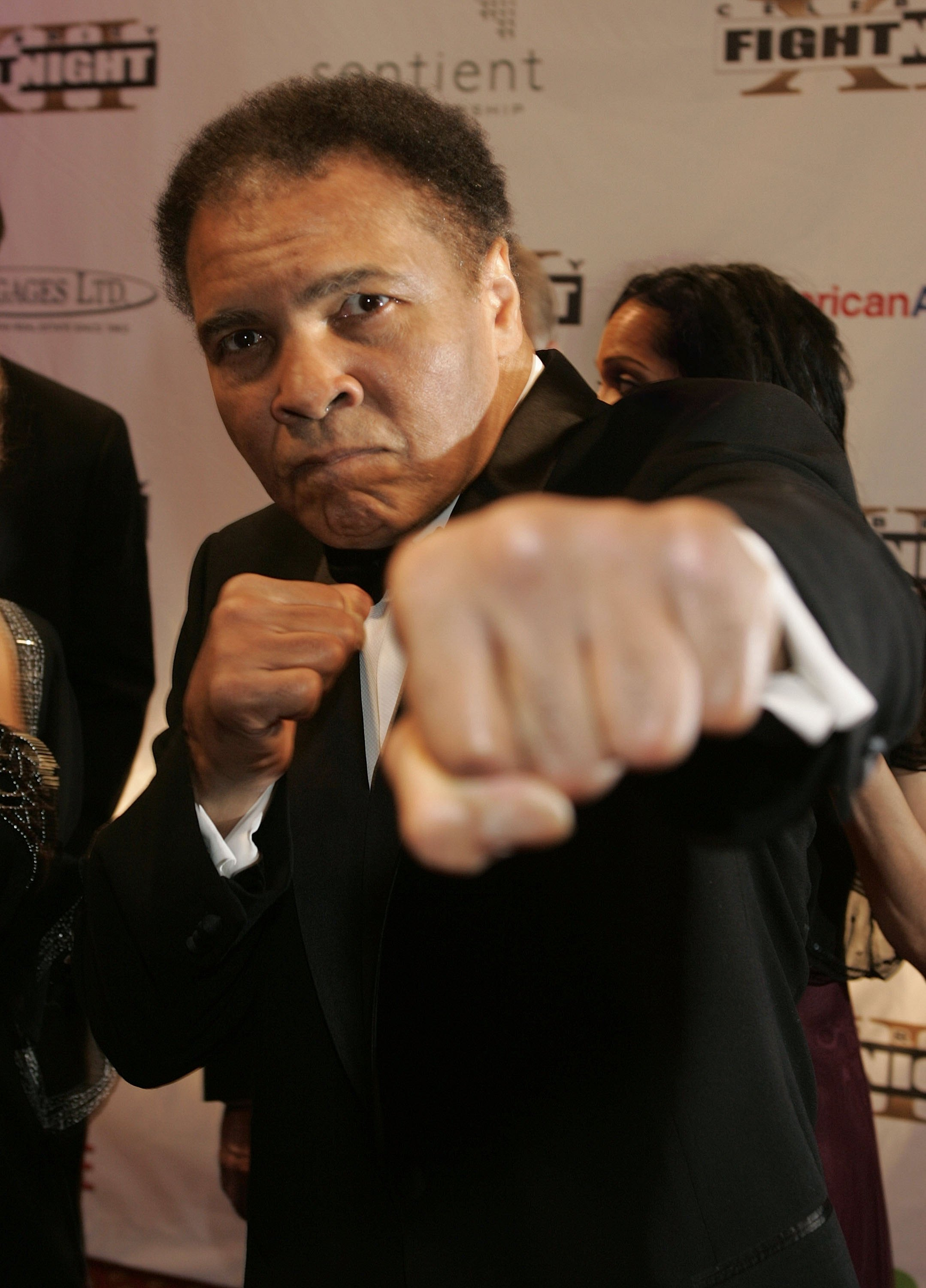 PHOENIX, AZ - MARCH 18: Muhammad Ali throws a punch at the camera on the red carpet for Celebrity Fight Night XII on March 18, 2006 at the JW Marriott Desert Ridge Resort & Spa in Phoenix, Arizona.  (Photo by Will Powers/Getty Images)
