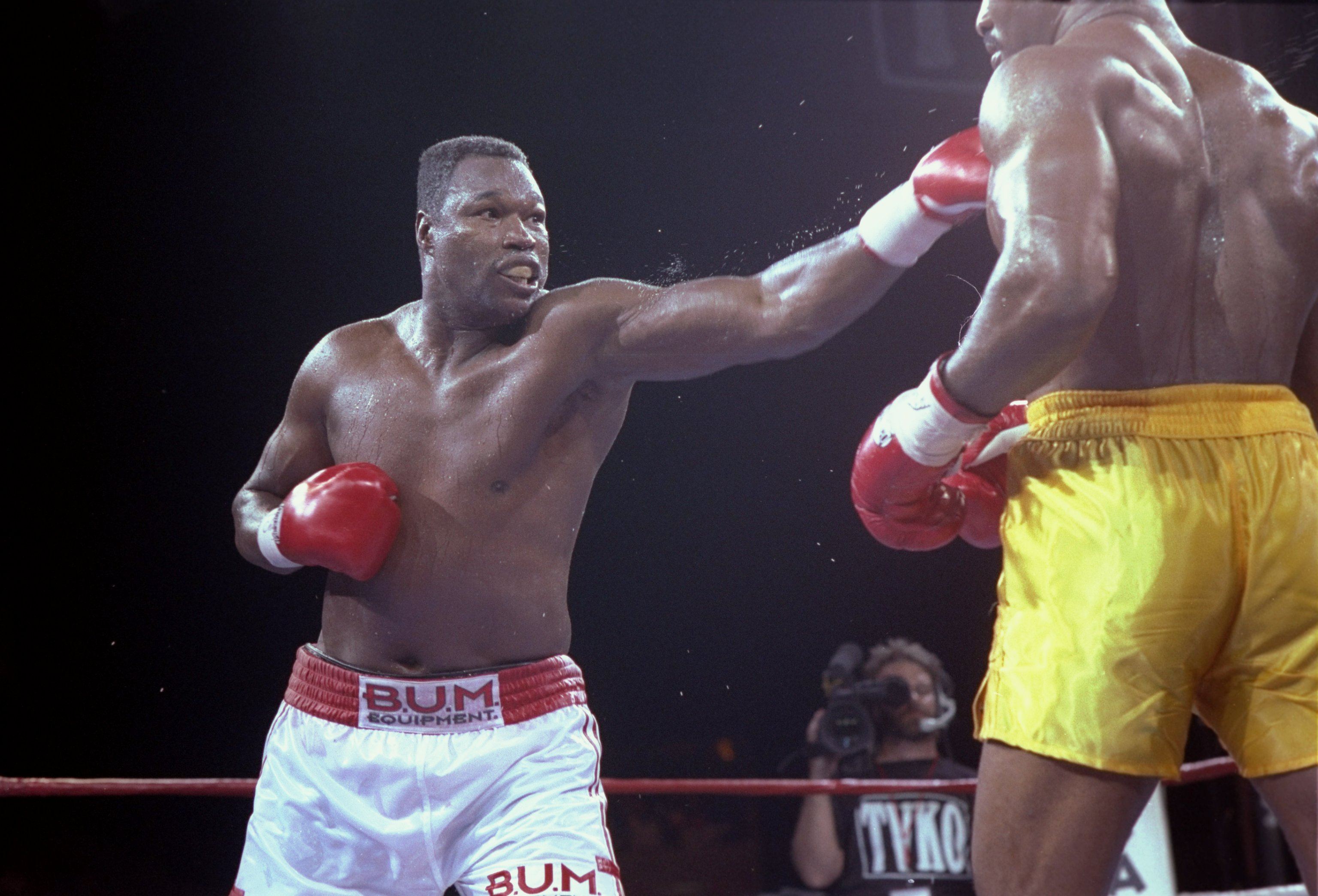 19 Jun 1992: Larry Holmes (left) lands a blow to the face of his opponent Evander Holyfield in Las Vegas, Nevada. Holyfield won the bout with an unanimous decision after 12 rounds.