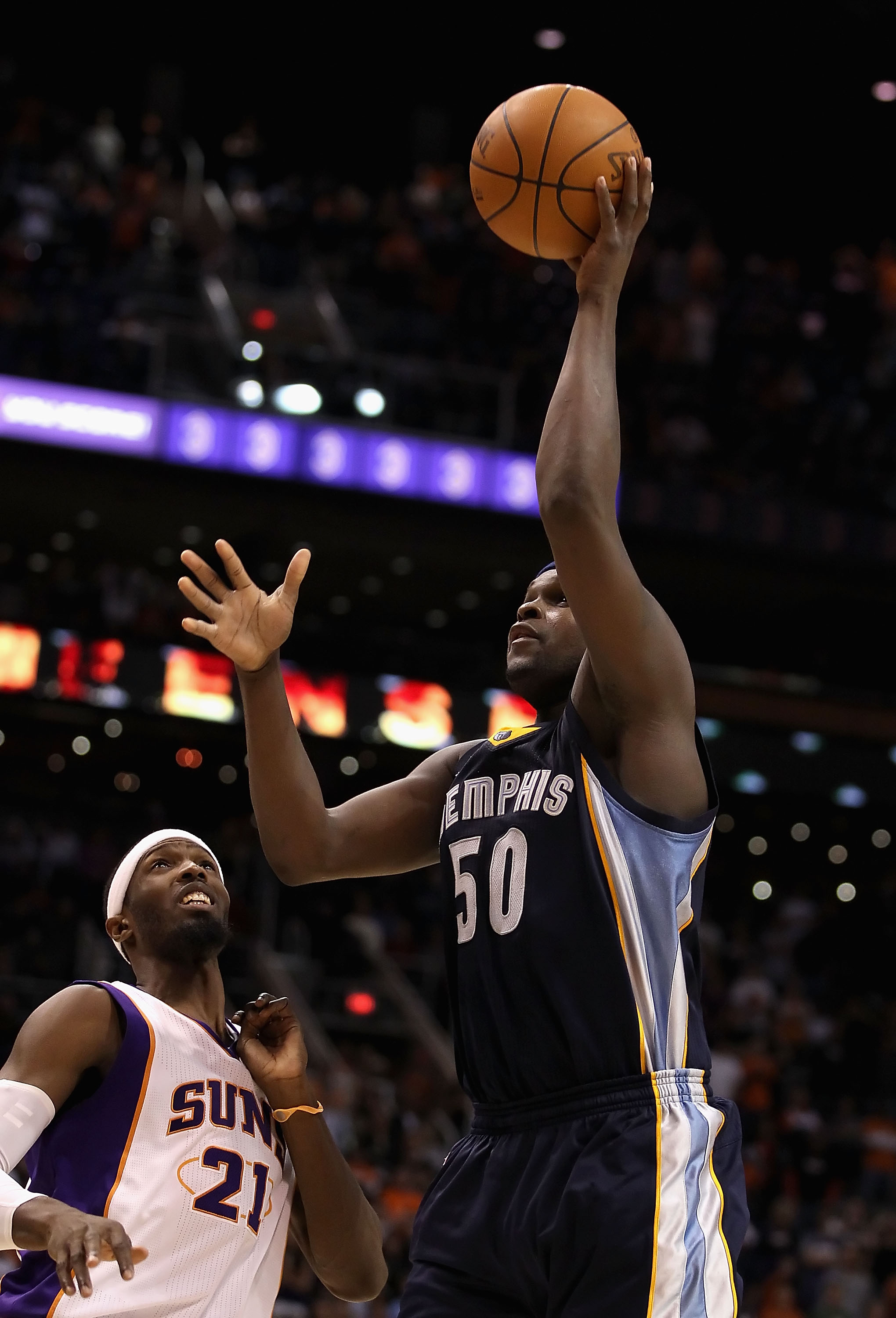 PHOENIX - DECEMBER 08:  Zach Randolph #50 of the Memphis Grizzlies puts up a shot against the Phoenix Suns during the NBA game at US Airways Center on December 8, 2010 in Phoenix, Arizona. NOTE TO USER: User expressly acknowledges and agrees that, by down