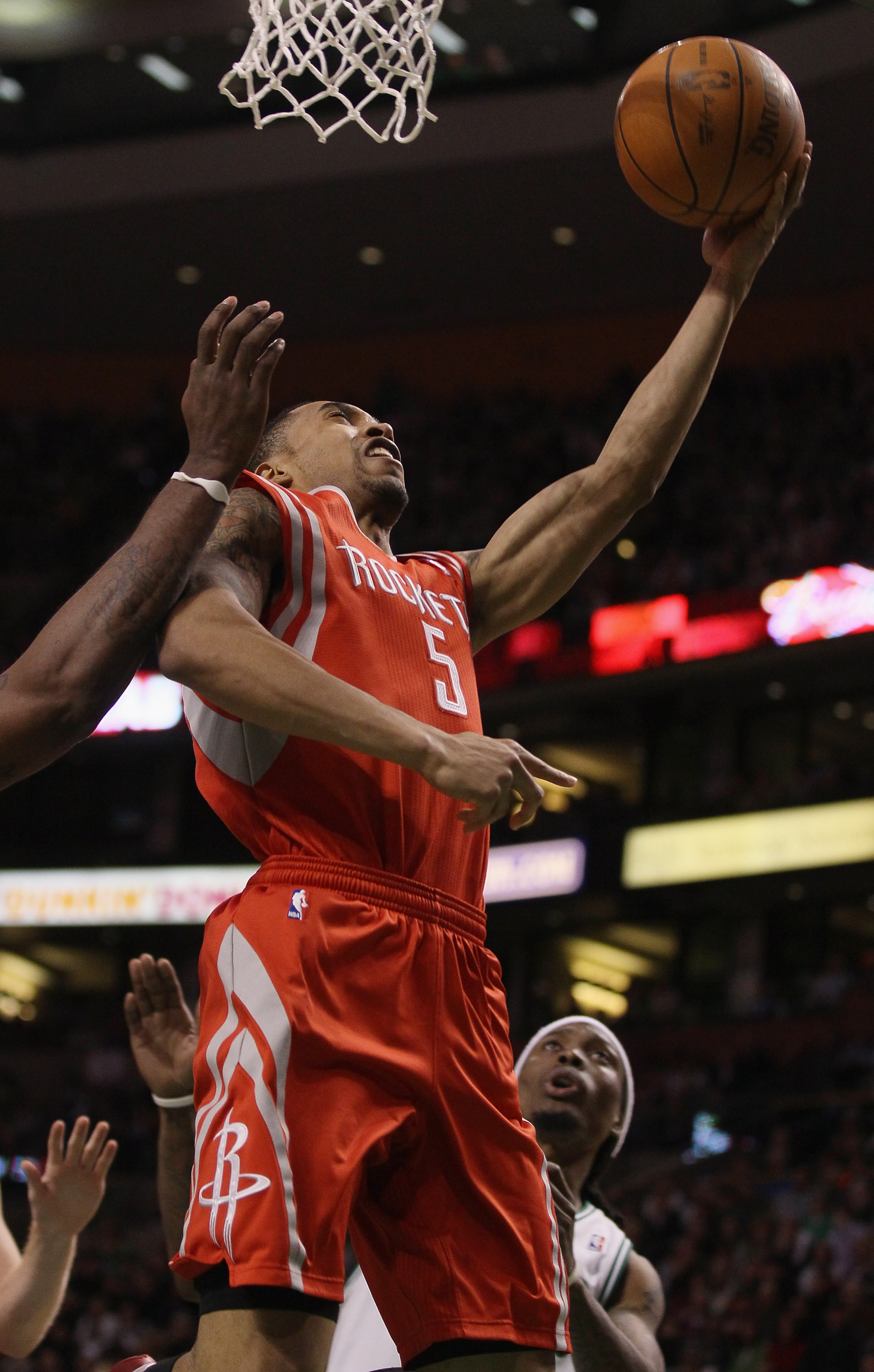 BOSTON, MA - JANUARY 10:  Courtney Lee #5 of the Houston Rockets takes a shot as Marquis Daniels #8 of the Boston Celtics defends on January 10, 2011 at the TD Garden in Boston, Massachusetts.  The Rockets defeated the Celtics 108-102. NOTE TO USER: User