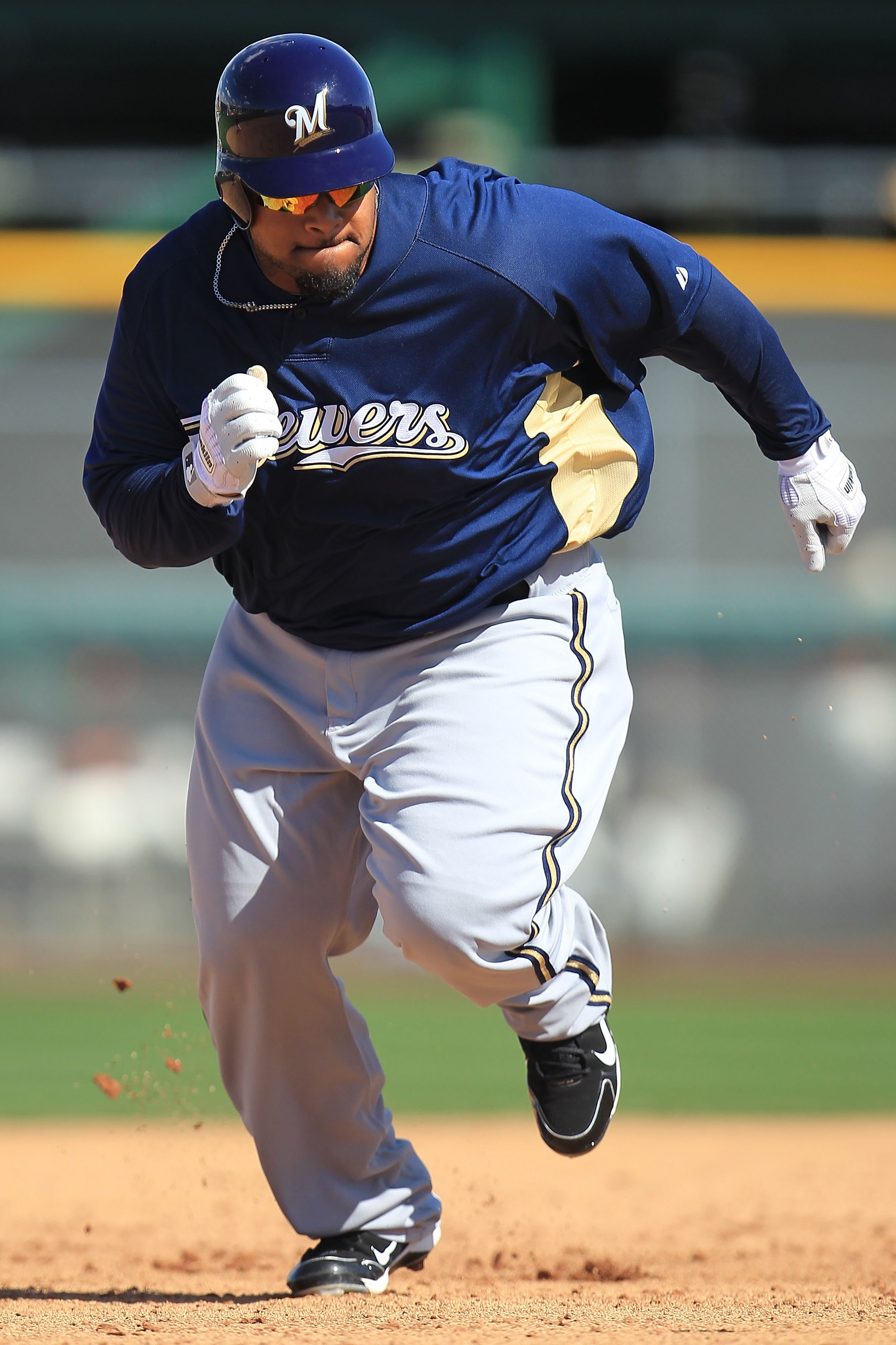 SCOTTSDALE, AZ - MARCH 04:  Prince Fielder #28 of the Milwaukee Brewers runs to third base against the San Francisco Giants during a spring training game at Scottsdale Stadium on March 4, 2010 in Scottsdale, Arizona.  (Photo by Chris McGrath/Getty Images)