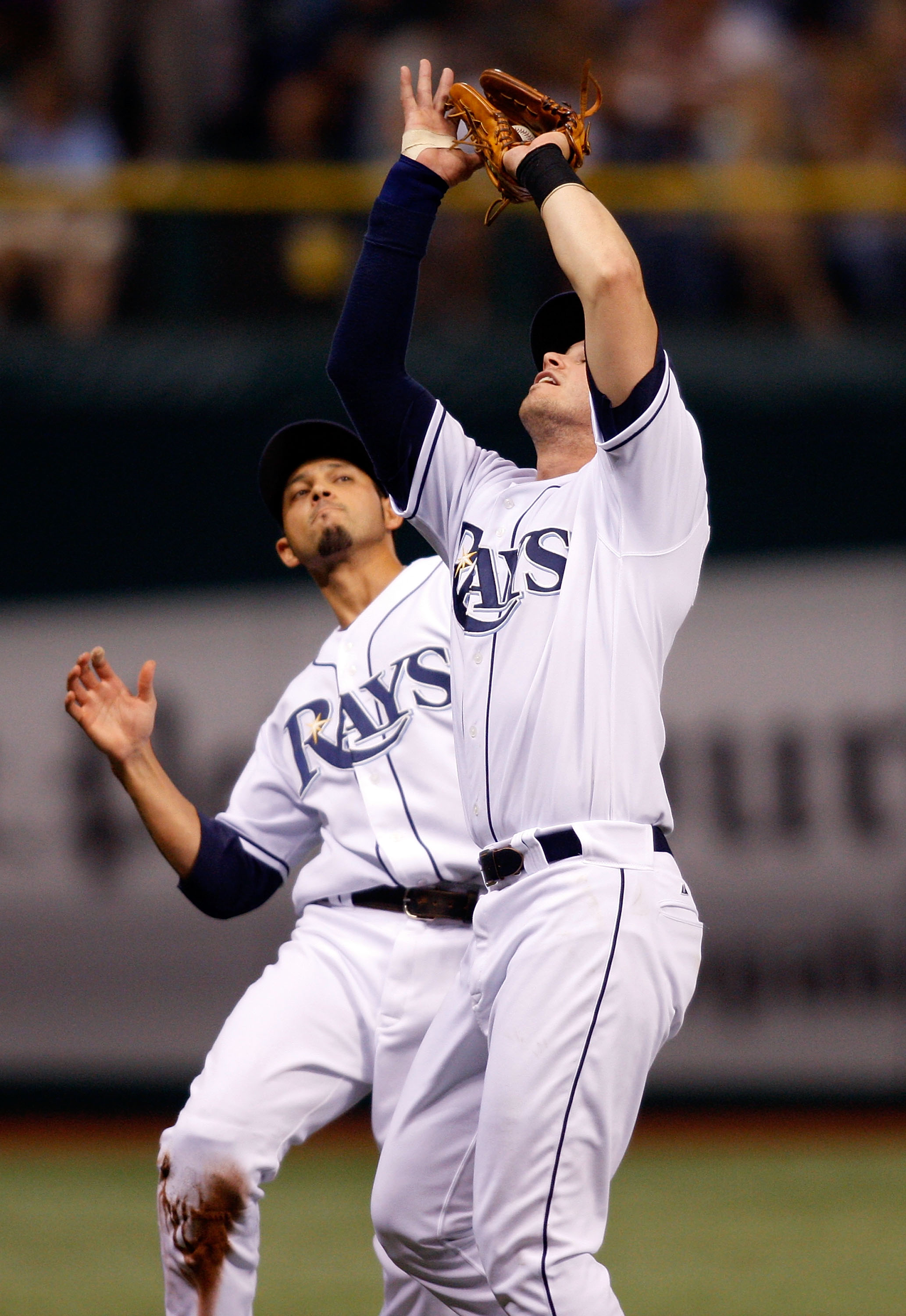 ST. PETERSBURG, FL - SEPTEMBER 19: Infielder Evan Longoria #3 of the Tampa Bay Rays catches a foul ball as shortstop Jason Bartlett #8 is there to back him up against the Minnesota Twins during the game on September 19, 2008 at Tropicana Field in St. Pete