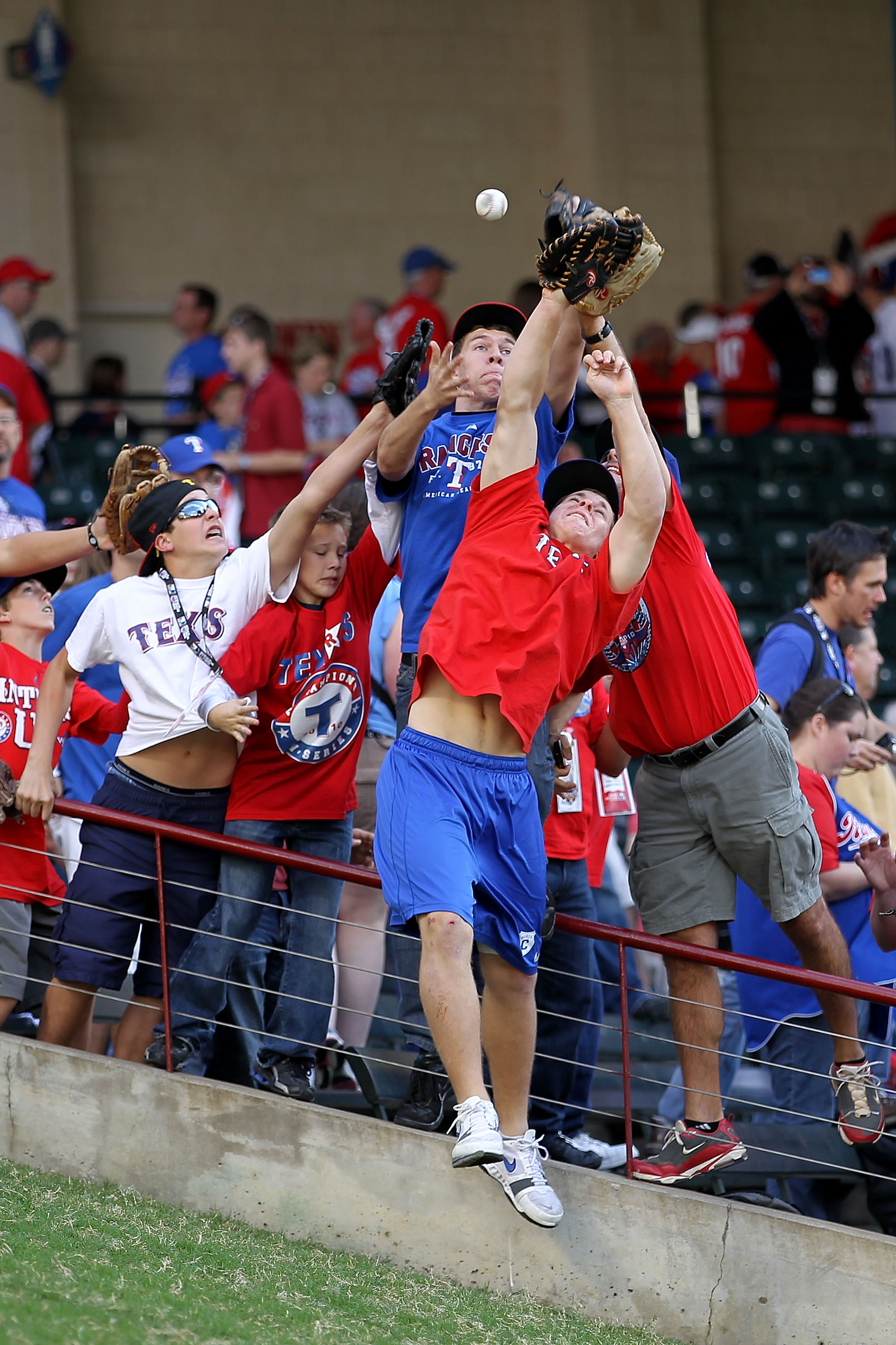 ARLINGTON, TX - NOVEMBER 01:  Fans attempt to catch home run balls during batting practice prior to the Texas Rangers playing against the San Francisco Giants in Game Five of the 2010 MLB World Series at Rangers Ballpark in Arlington on November 1, 2010 i